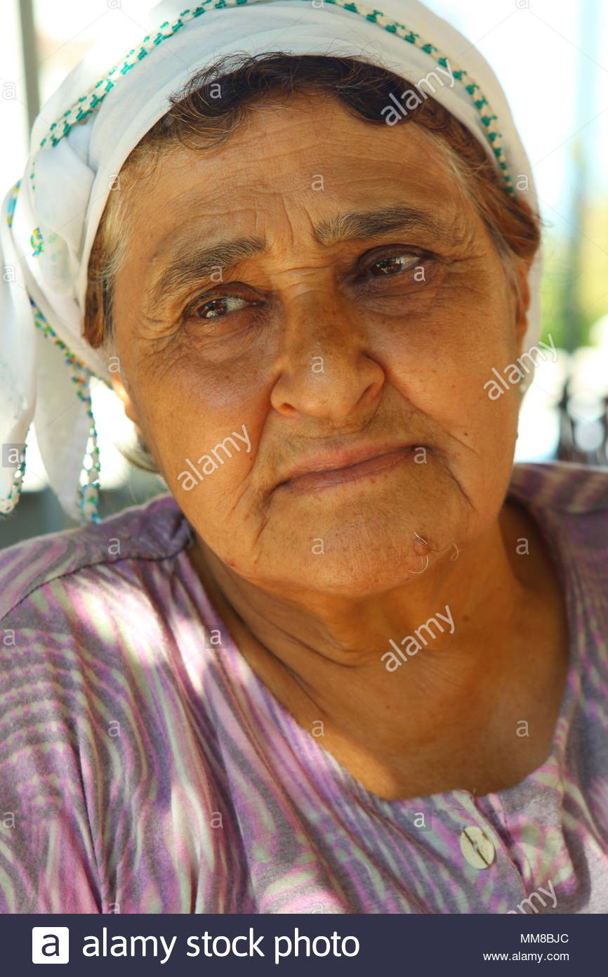 An Elderly Turkish Lady Posing In Traditional Headwear Under
