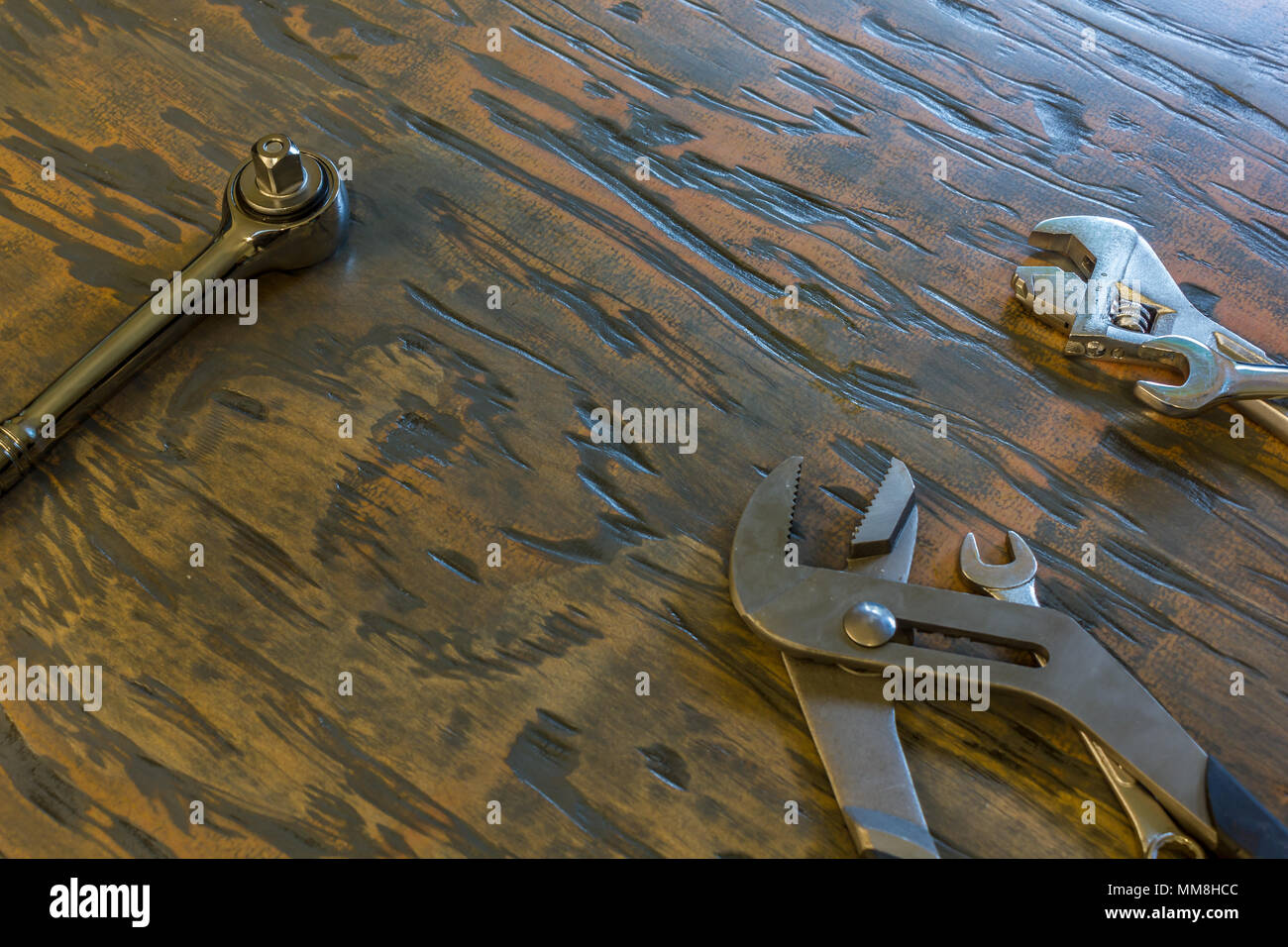 wrenches and tolls on wood board - Stock Image