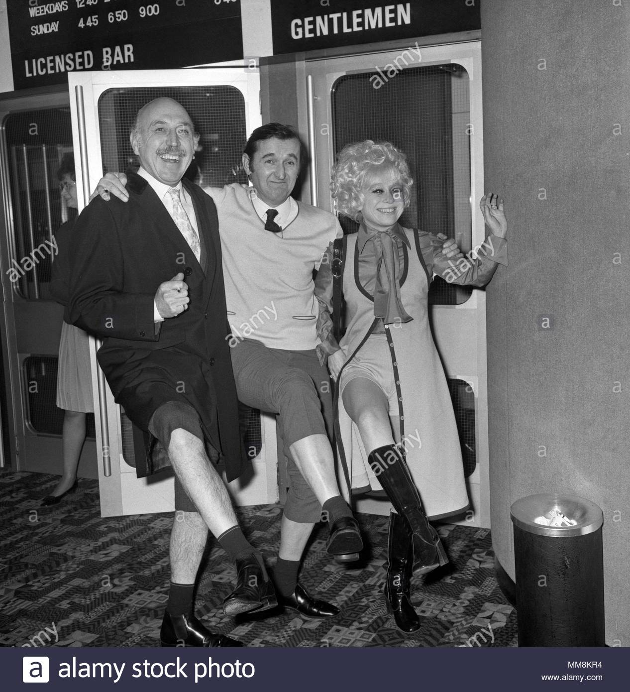 File photo dated 11/02/1971 of EastEnders and Carry On actress Barbara Windsor (right) who, her husband says, has been diagnosed with Alzheimer's, with Lionel Jeffries and Graham Stark the premiere of the film 'Percy' at ABC1, Shaftesbury Avenue, central London. - Stock Image