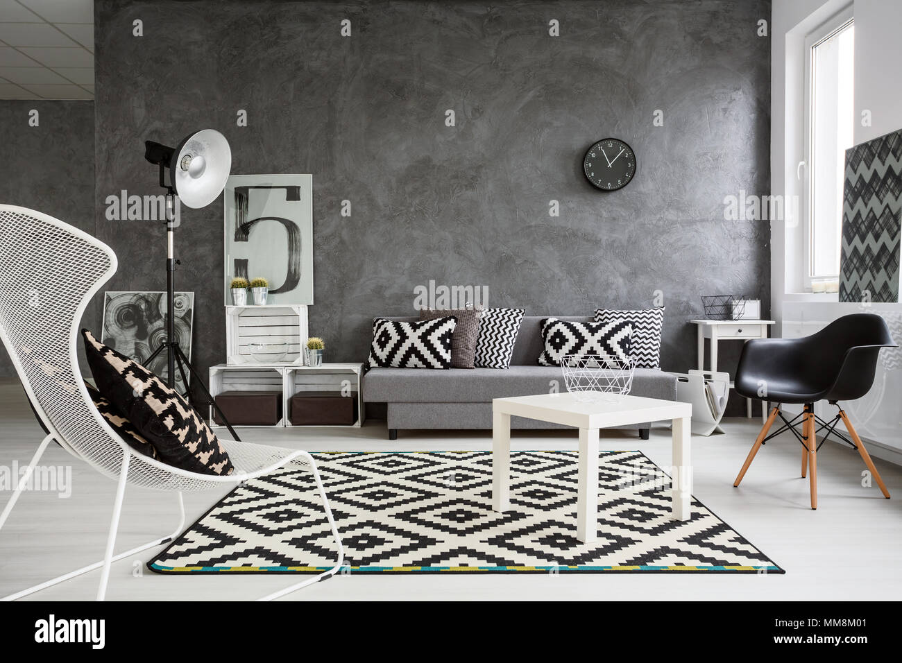 Spacious classic living room in black and white. Interior designed with style Stock Photo