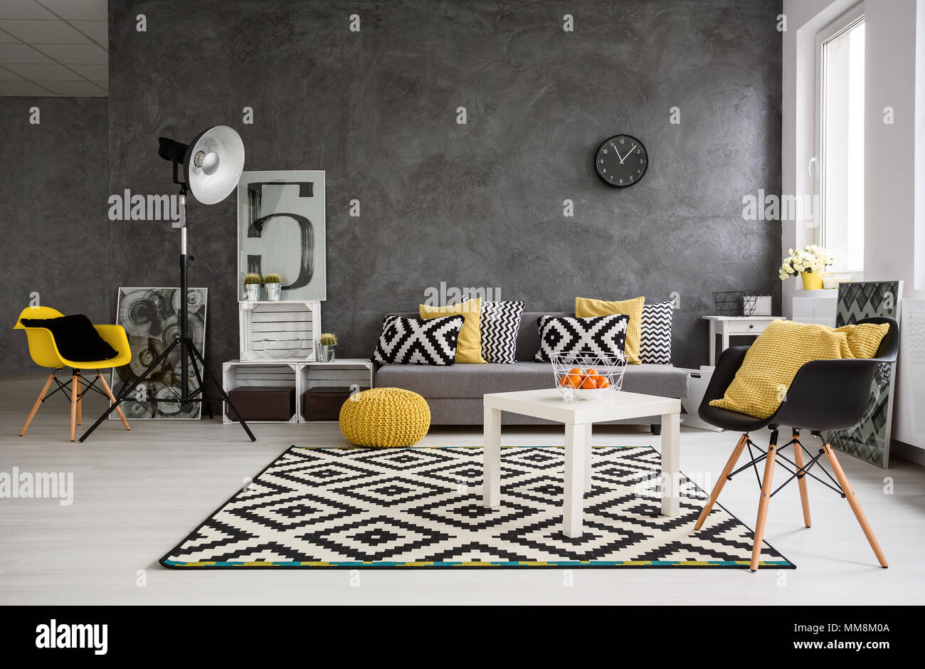 Stylish spacious living room with grey walls and black - Black white yellow living room ideas ...