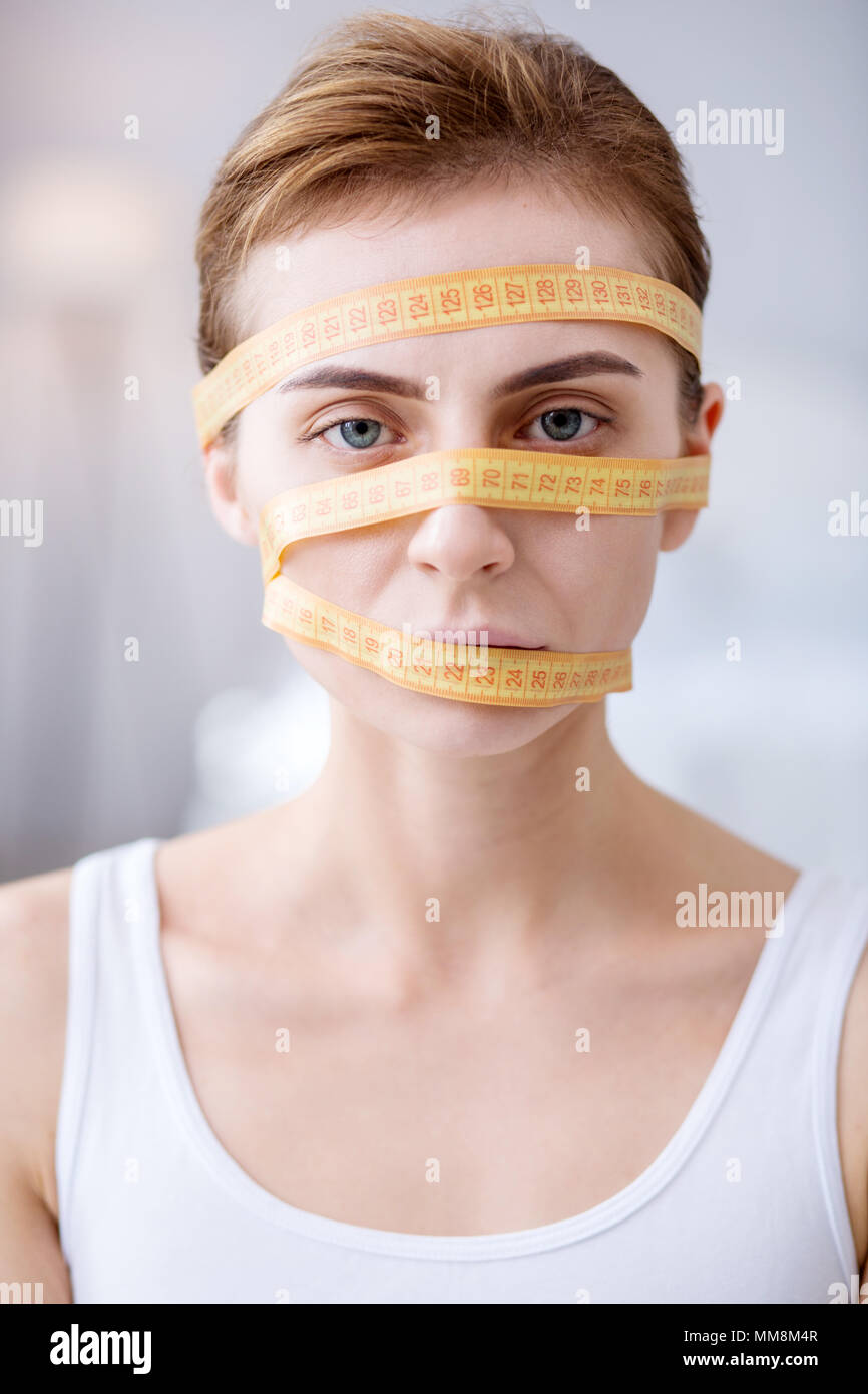 Portrait of a silent young woman - Stock Image