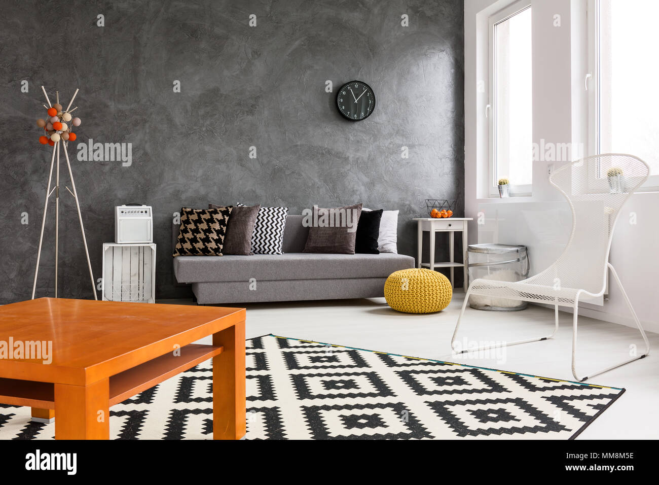 Creative Design Of Spacious Living Room With Black White And Orange Decorations Stock Photo Alamy