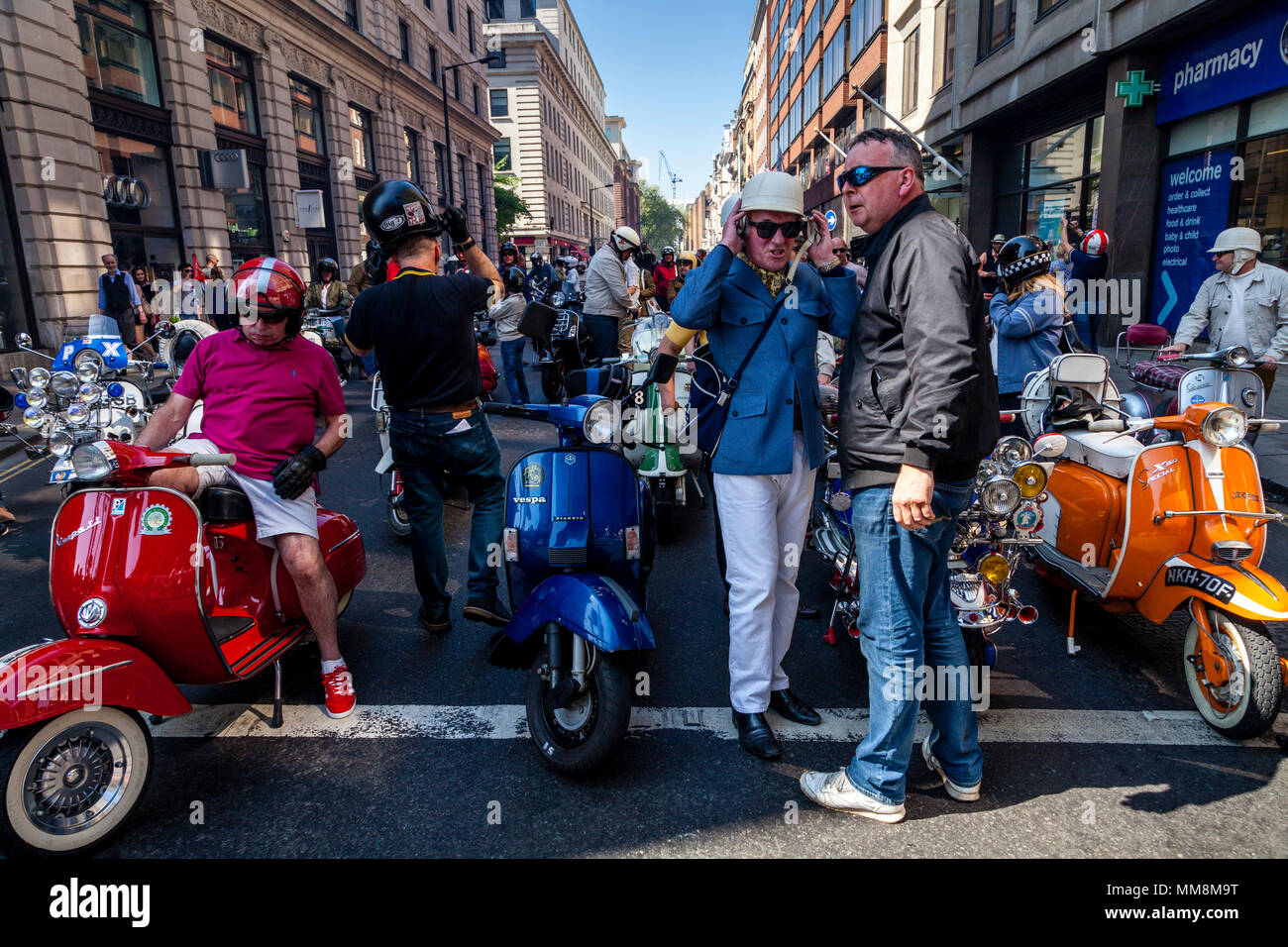 Scooter Owners Prepare To Take Part In A Bank Holiday Scooter Rally, London, England - Stock Image