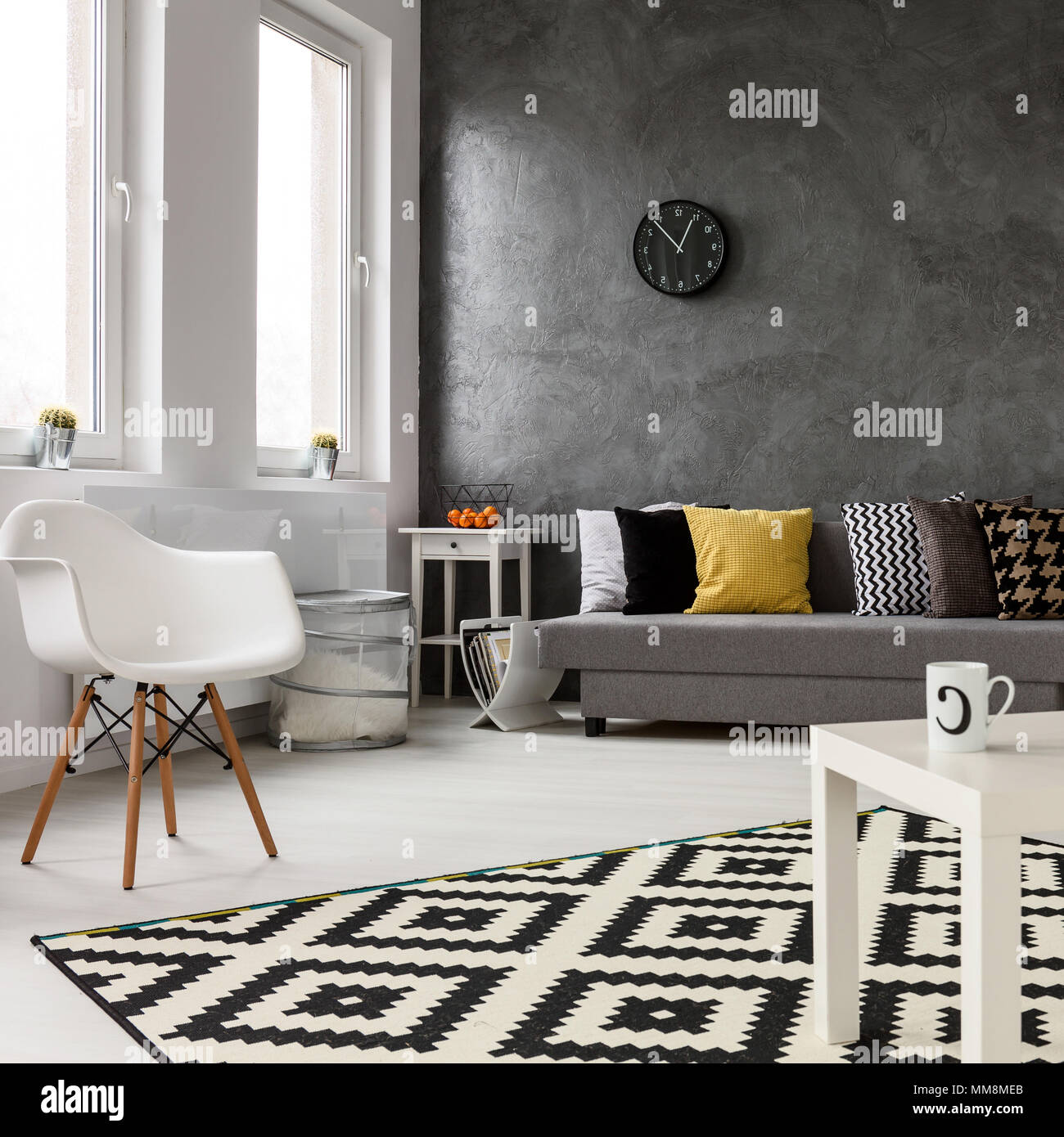 Spacious lounge with modern stylish design with grey walls and white ...