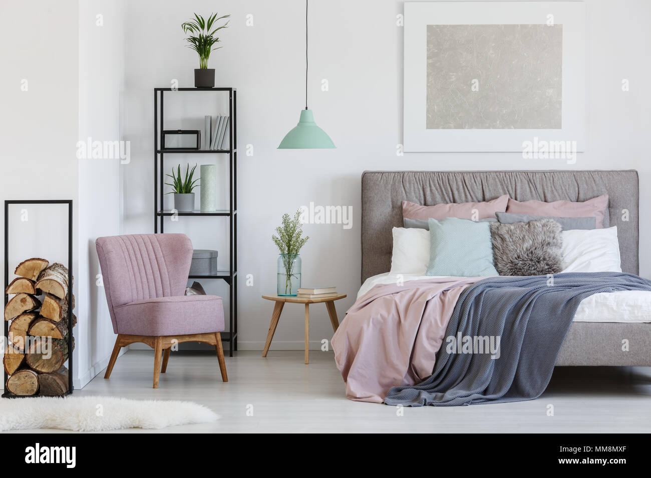 Pink comfy armchair placed in the corner of teen girl's room - Stock Image