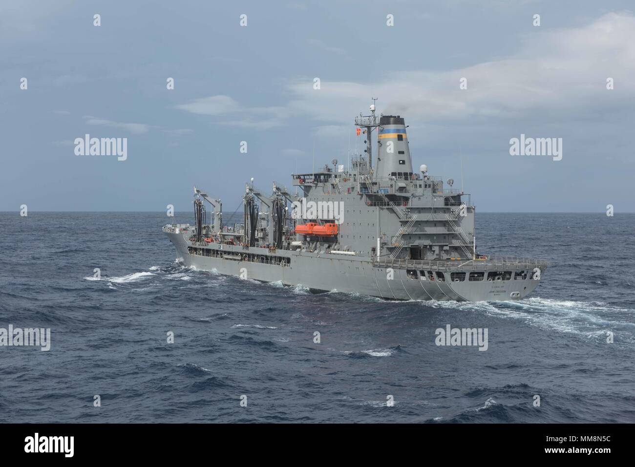 170913-N-PF593-031 PHILIPPINE SEA (Sept. 13, 2017) Military Sealift Command's fleet replenishment oiler, USNS John Ericsson (TA-O 194), steams alongside The Navy's forward-deployed aircraft carrier, USS Ronald Reagan (CVN 76), before conducting a refueling-at-sea. John Ericsson provides underway replenishment fuel, fleet cargo, and stores to ships at sea. Ronald Reagan provides a combat-ready force, which protects and defends the collective maritime interests of the U.S. and its allies and partners in the Indo-Asia-Pacific region. (U.S. Navy photo by Mass Communication Specialist 2nd Jamal McN - Stock Image