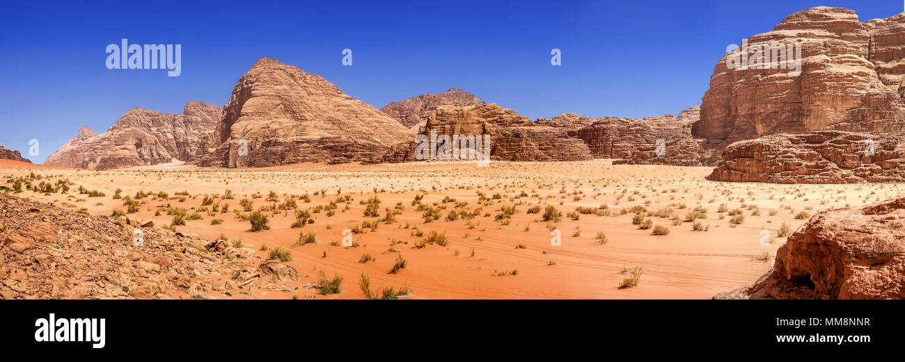 Composite panorama of high resolution aerial photos of a monolithic mountain in the central area of the desert reserve of Wadi Rum, Jordan, middle eas Stock Photo