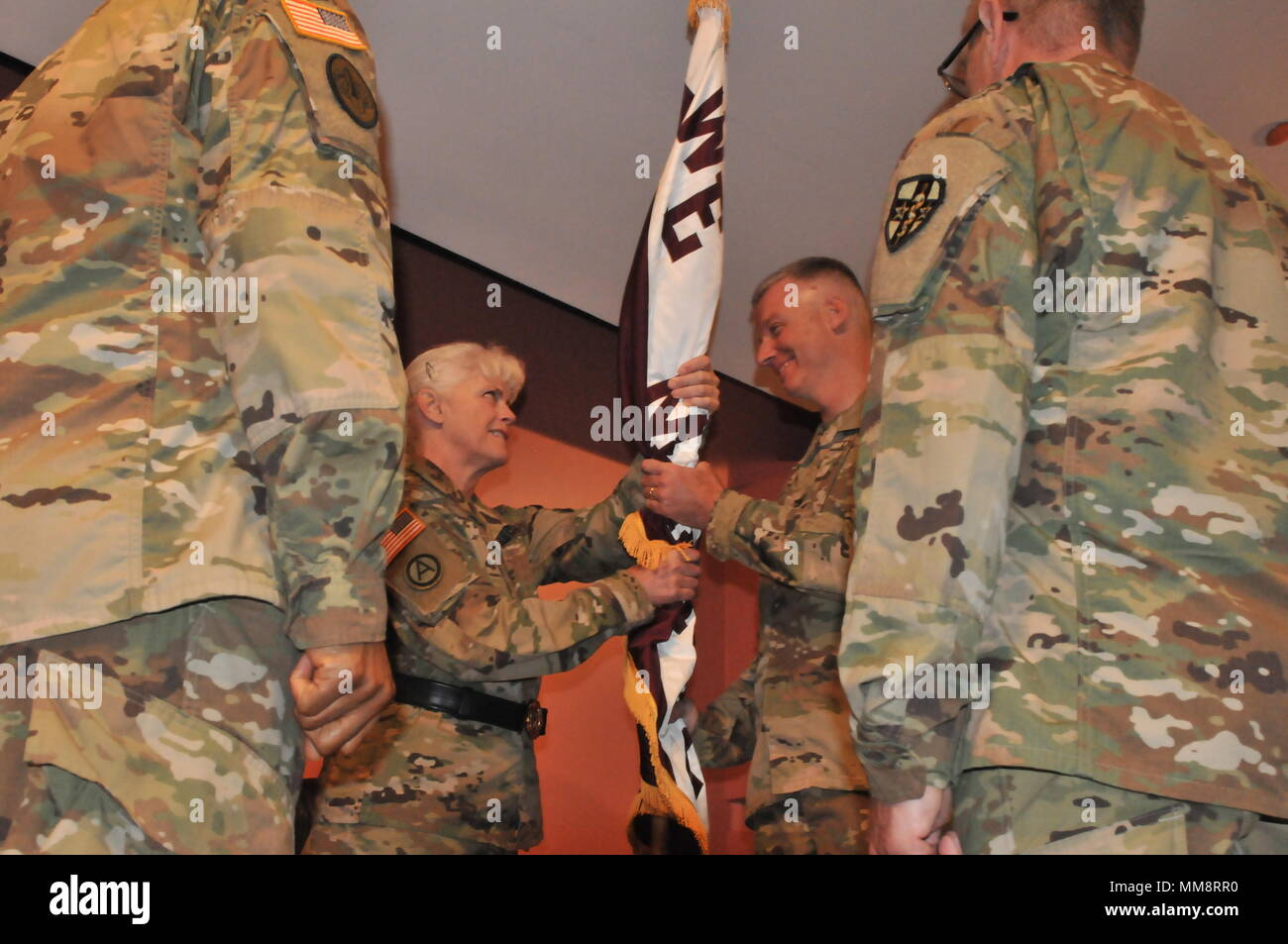 The change of command is a traditional event rich with symbolism and heritage. Here Maj. Gen. Mary Link, commander of Army Reserve Medical Command gives the unit colors of Western Medical Area Readiness Support Group to Col. Thad Collard, who is now the commander for the next two years of WE MARSG in San Pablo, California with units in Arizona, Colorado, New Mexico, Nevada, Montana, Washington and California. The change of command happened the 10th of September, 2017. - Stock Image