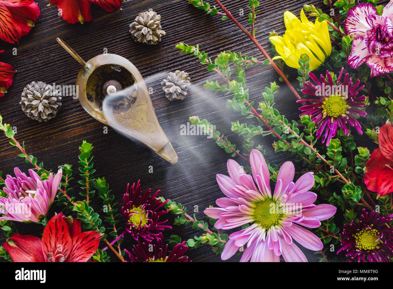 Burning Incense with Summer Flowers and Foliage - Stock Image