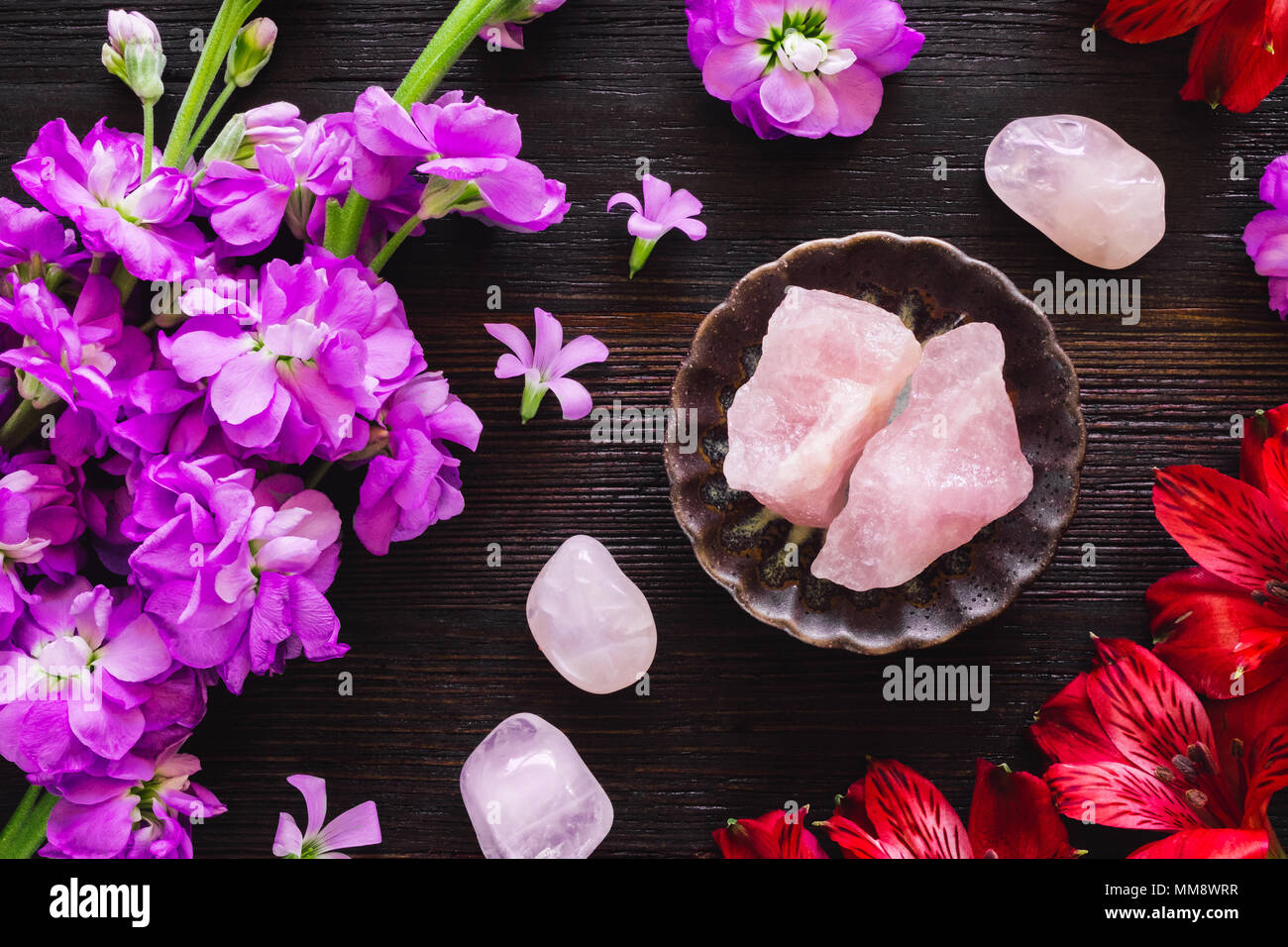 Ceramic Bowl of Rose Quartz with Gladiolus and Lily of the Incas - Stock Image