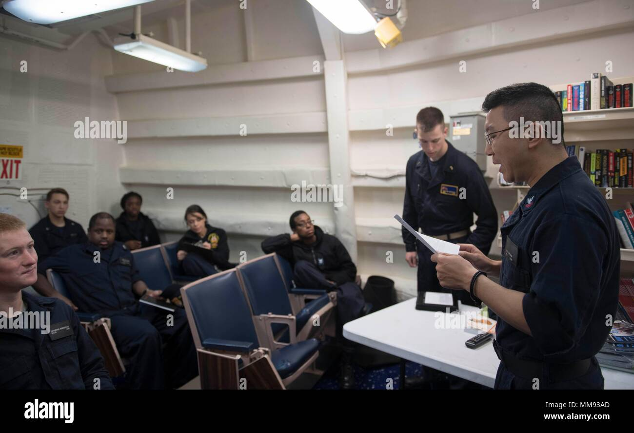 170913-N-WV703-0079 ATLANTIC OCEAN (Sept. 13, 2017) Personnel Specialist 2nd Class Kai Fang conducts personal protective equipment training for the administrative division aboard the Arleigh Burke-class guided-missile destroyer USS Winston S. Churchill Sept. 13, 2017. Winston S. Churchill, homeported at Naval Station Norfolk, is conducting naval operations in the U.S. 6th Fleet area of operations in support of U.S. national security interests in Europe. (U.S. Navy photo by Mass Communication Specialist 2nd Class Amy M. Ressler/Released) - Stock Image