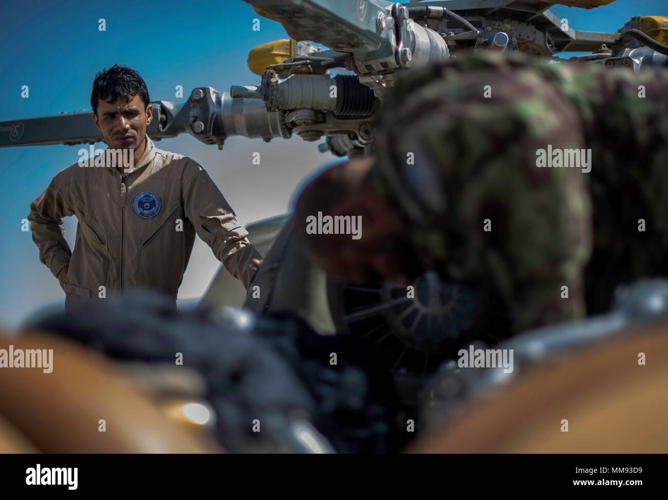 Afghan Air Force personnel conduct maintenance on an Mi-17 before the arrival of two UH-60s at Kandahar Air Field, Afghanistan, on Sept. 18, 2017. The UH-60s are the first to be delivered to the AAF under the recapitalization program. The plan to recapitalize the AAF and increase its size will provide firepower and mobility enabling the Afghan National Defense and Security Forces to break the stalemate with insurgents. (U.S. Air Force photo by Staff Sgt. Trevor T. McBride) - Stock Image