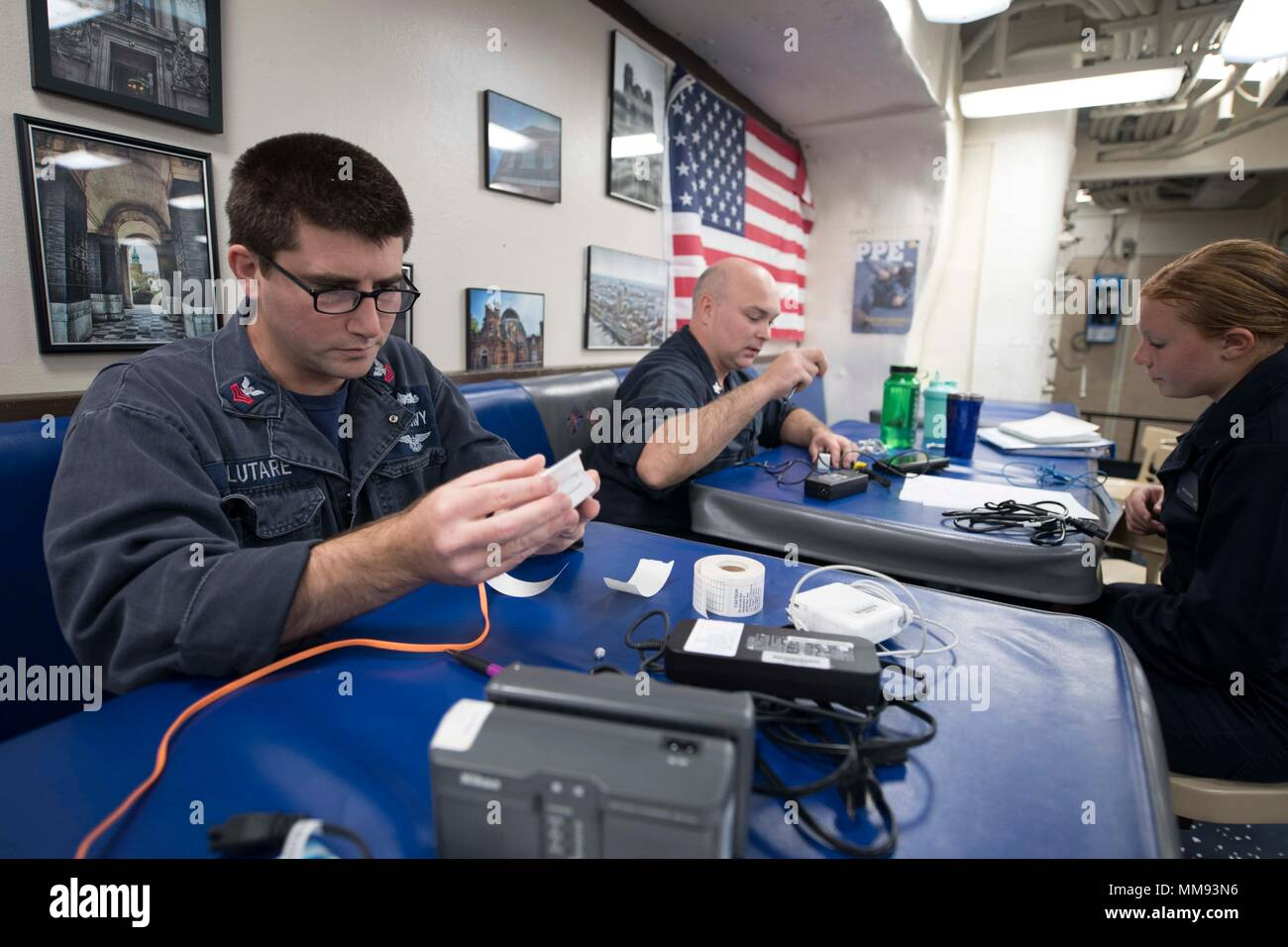 170912-N-WV703-0059 ATLANTIC OCEAN (Sept. 12, 2017) Electrician's Mate 1st Class Nicholas Salutare, from Pine Bush, New York, left, and Electrician's Mate 2nd Class Matthew Holland, from Noris Town, Pennsylvania, conduct safety checks and tagging of electrical equipment for Sailors aboard the Arleigh Burke-class guided-missile destroyer USS Winston S. Churchill (DDG 81) Sept. 12, 2017. Winston S. Churchill, homeported at Naval Station Norfolk, is conducting naval operations in the U.S. 6th Fleet area of operations in support of U.S. national security interests in Europe. (U.S. Navy photo by Ma Stock Photo