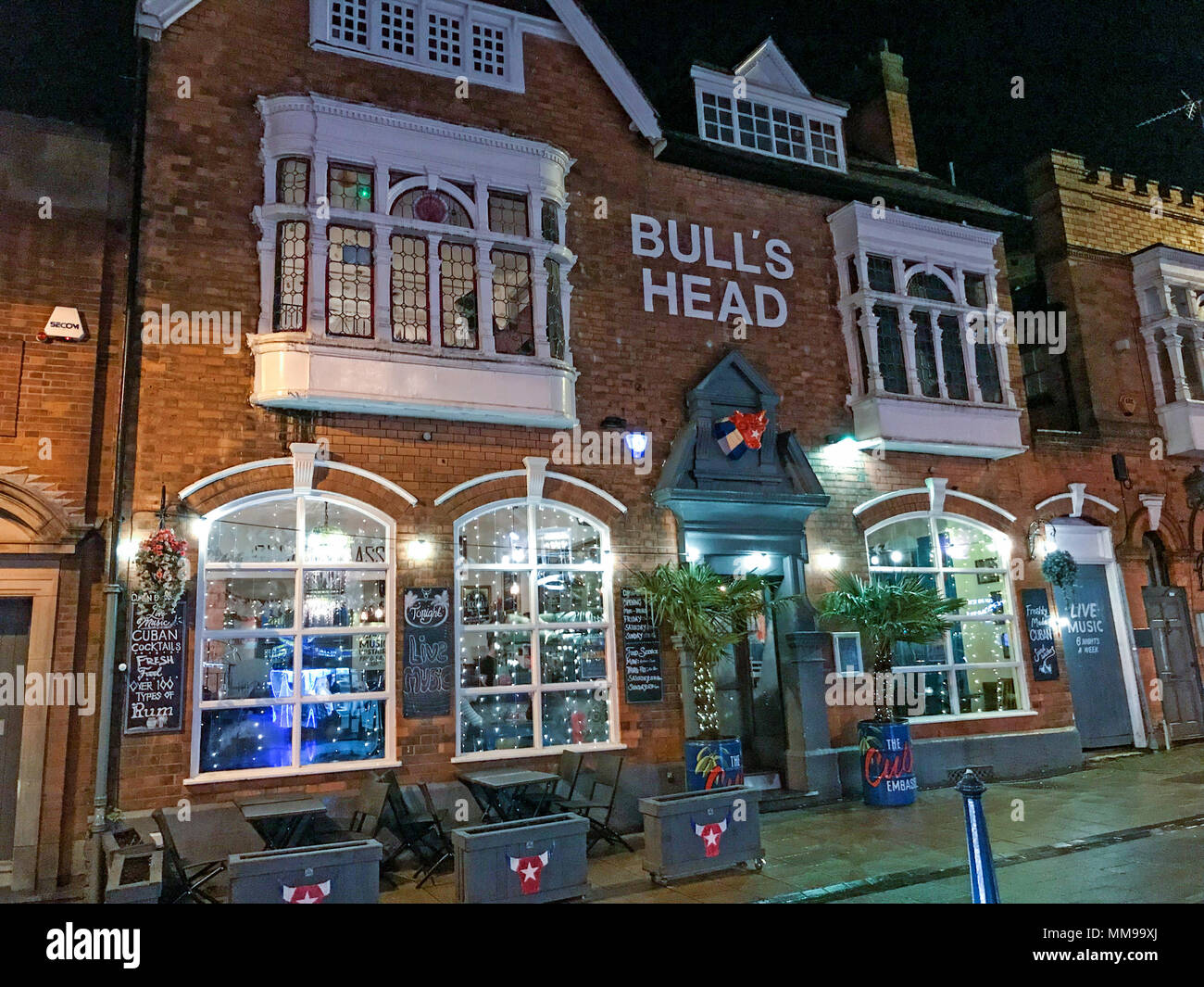 Bulls Head pub at night, 19 St Mary's Row, Moseley, Birmingham B13 8HW, UK - Stock Image
