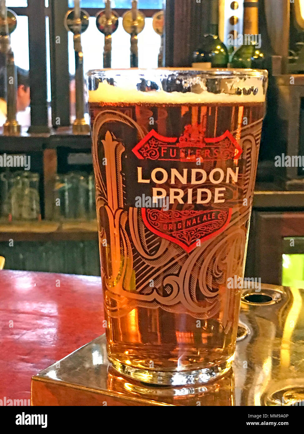 Pint of London Pride, on a bar in the City of London, England, UK - Stock Image