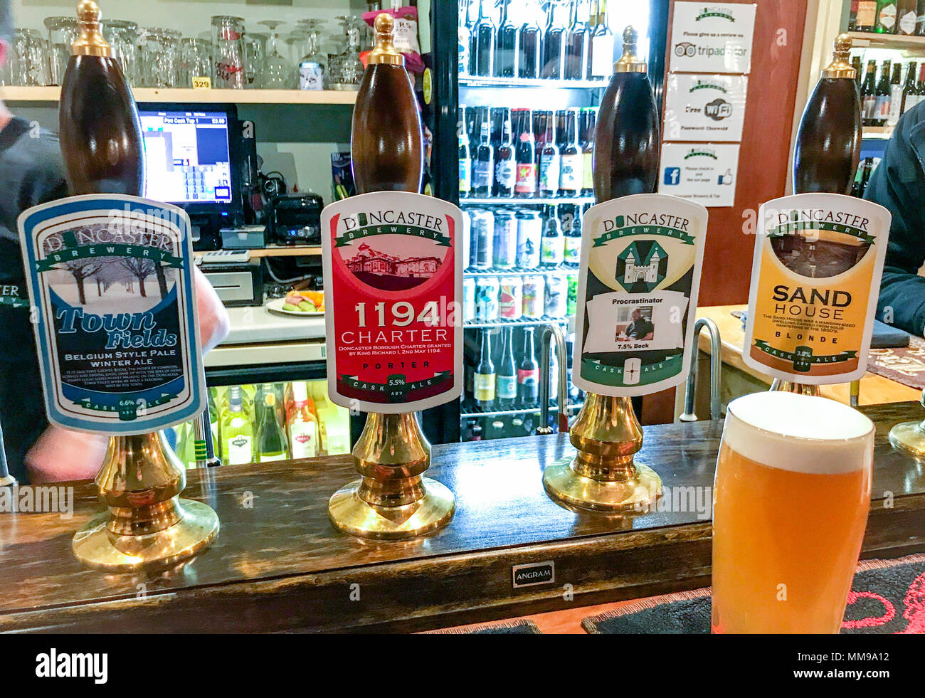 Doncaster Brewery Beer pumps on a bar, in a traditional English pub, South Yorkshire, England, UK - Stock Image