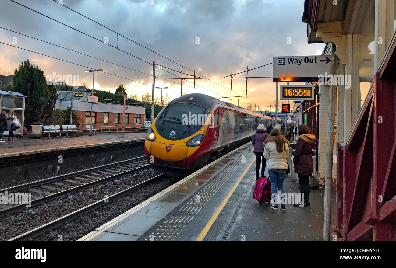 Virgin Pendolino arrives at Motherwell Railway Station, North Lanarkshire, Scotland in the evening, UK - Stock Image