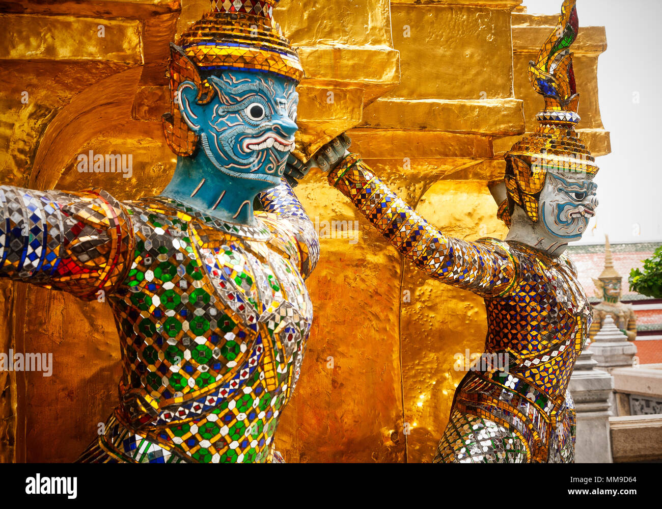 Scary looking characters ward away demons on the grounds of the Grand Palace.  Bangkok, Thailand. - Stock Image
