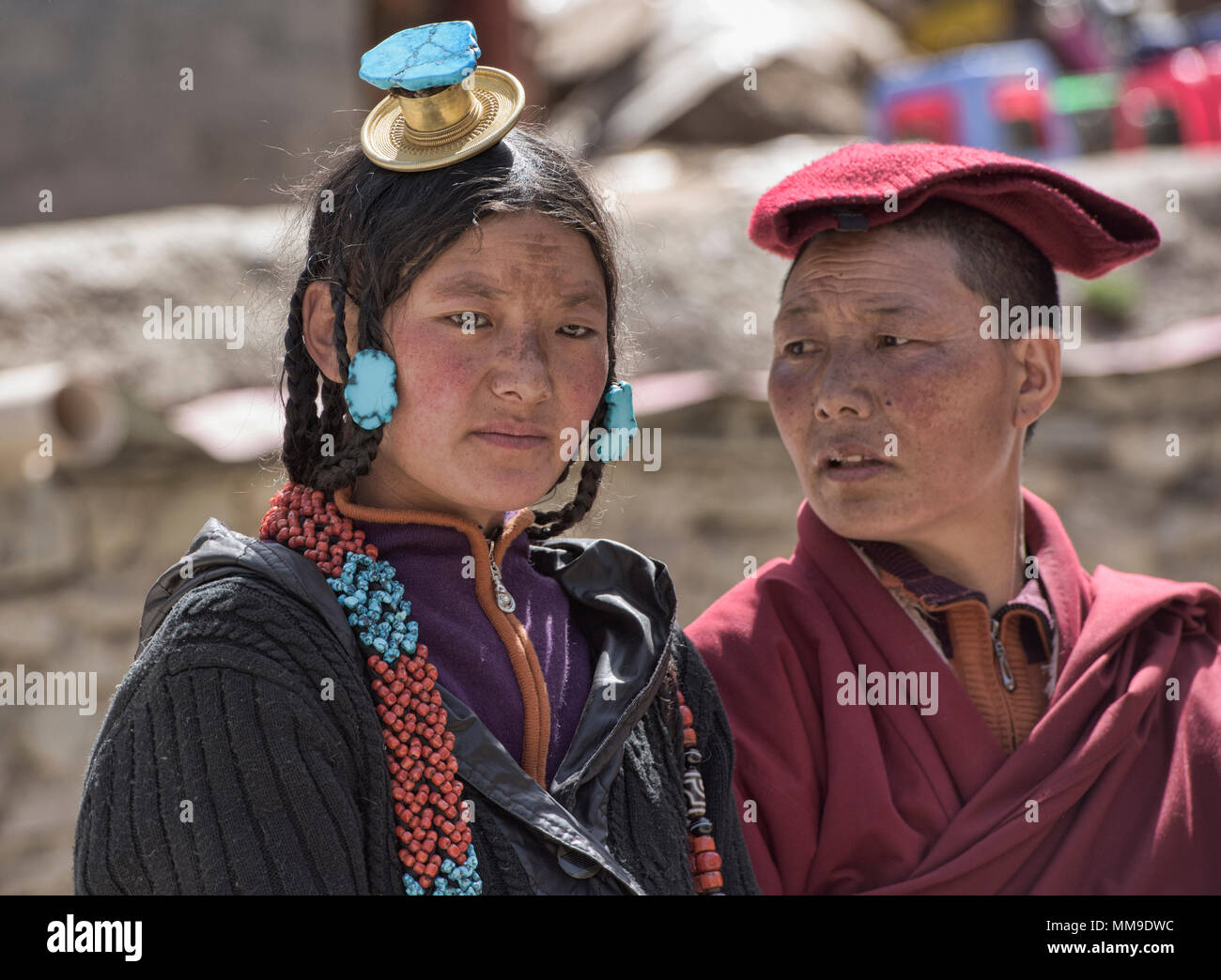 Tibetan pilgrims outside the holy Bakong Scripture Printing Press Monastery in Dege, Sichuan, China - Stock Image