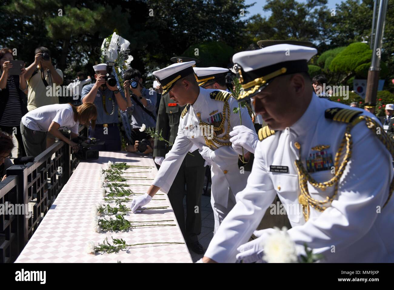 170915-N-TB148-155 Incheon, Republic of Korea (Sept. 15, 2017)Capt. Hank Kim, chief of staff of Commander, U.S. Naval Forces Korea, and Capt. Kwang Lee, U.S. Navy Attache', lay flowers at the Gen. Douglas MacArthur statue during the 67th Incheon Landing Operations Commemoration Ceremony.  Incheon landing was a combined U.S. and ROK military assault during the Korean War is considered one of the most significant and successful operations in the history of amphibious warfare. (U.S. Navy photo by Mass Communication Specialist Seaman William Carlisle) Stock Photo