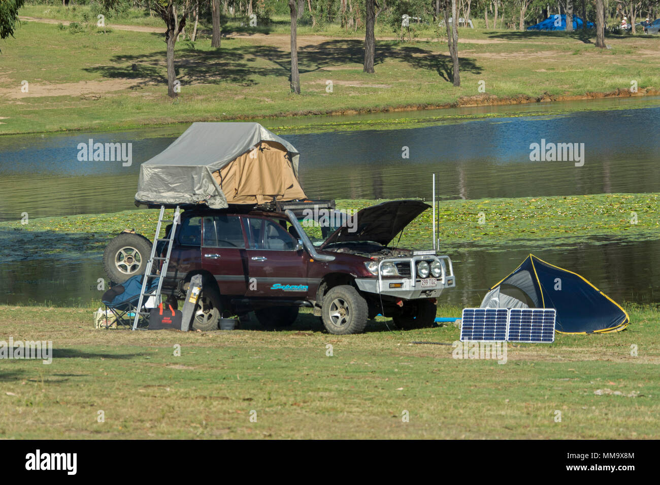 Four-wheel drive vehicle with rooftop tent c&ing gear and solar panel on & Car Rooftop Tent Stock Photos u0026 Car Rooftop Tent Stock Images - Alamy