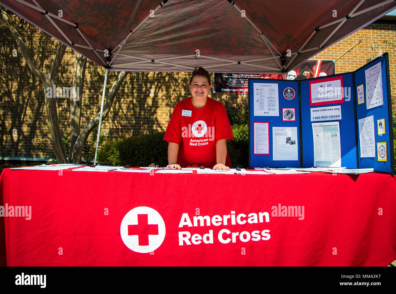 Amber Meza, American Red Cross (ARC) volunteer, poses for a
