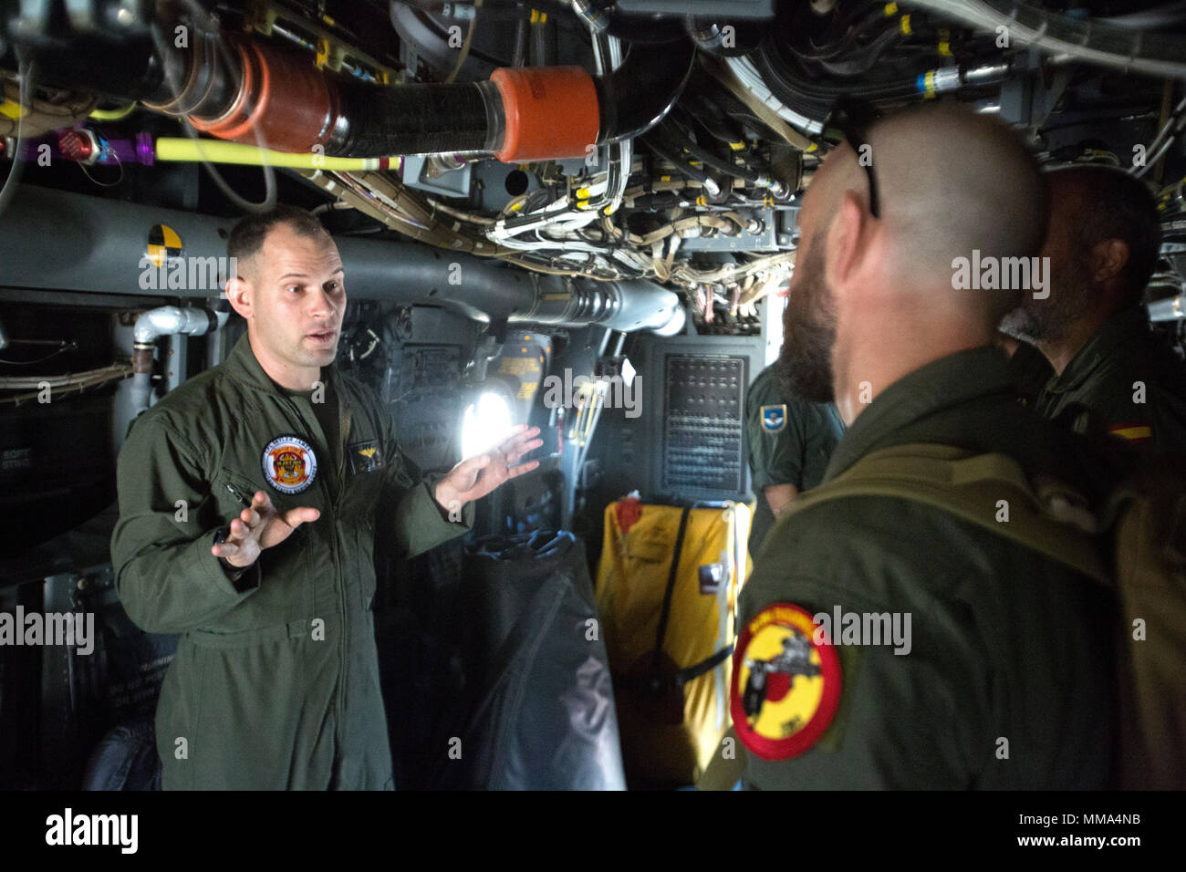 Captain Jonathan D. Hoy, an MV-22B Osprey pilot with Special Purpose Marine Air-Ground Task force-Crisis Response-Africa aviation combat element, speaks with members of the Spanish military about the Osprey's capabilities during the Spanish military's airshow at Naval Station Rota, Spain, Sept. 15, 2017. The airshow commemorated the 100-year anniversary of Spanish aviation. (U.S. Marine Corps Photo by SSgt. Kenneth K. Trotter Jr. - Stock Image