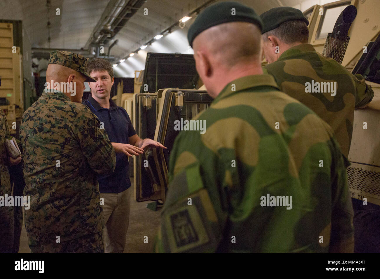 Commandant of the Marine Corps Gen. Robert B. Neller, left, tours facilities in Frigård, Norway, Sept. 29, 2017. Neller visited Norway to strengthen the military-to-military relationship between the two countries. (U.S. Marine Corps photo by Cpl. Samantha K. Braun) Stock Photo