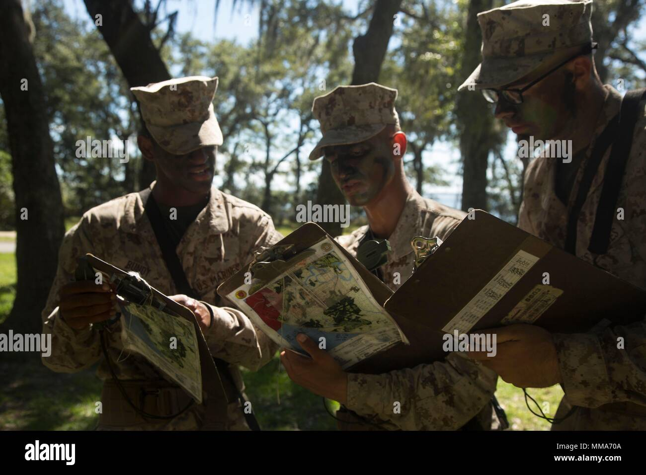 U.S. Marine Corps Recruits with Delta Company, 1st Battalion, Recruit Training Regiment, record their plot points at Elliot's Beach on Marine Corps Recruit Depot, Parris Island, S.C., Sept. 25, 2017.  The Land Navigation Course teaches recruits how to properly navigate unfamiliar terrain.  (U.S. Marine Corps photo by Lance Cpl. Yamil Casarreal/Released) Stock Photo
