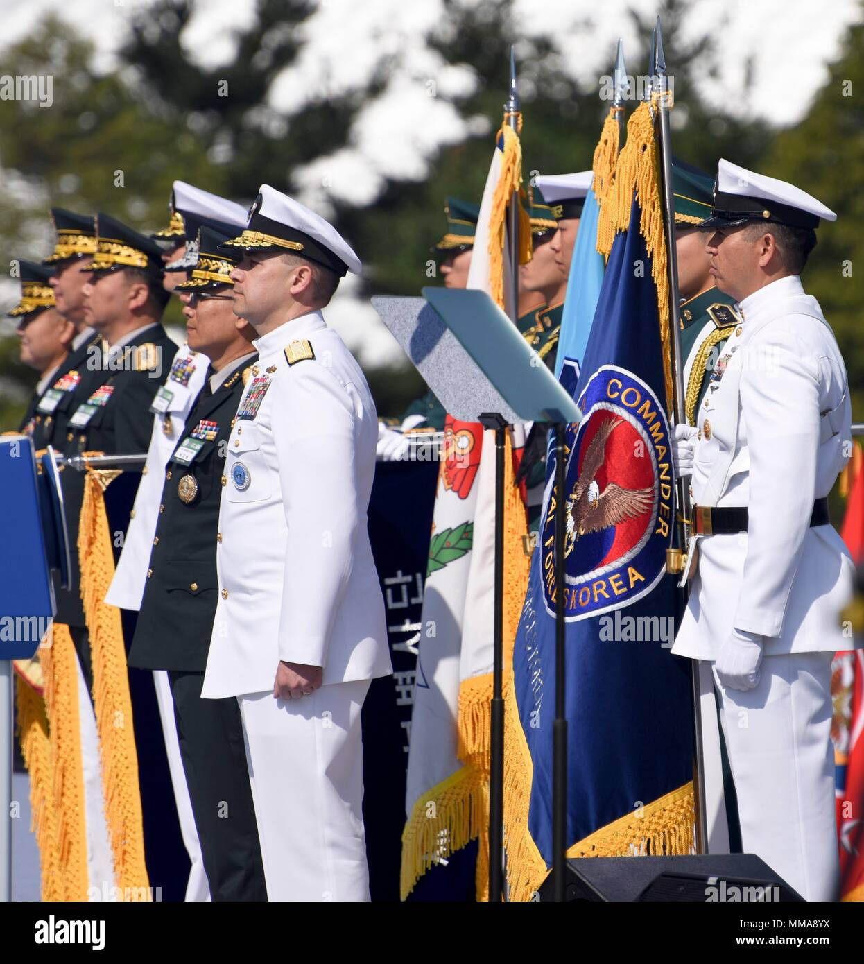 170928-N-TB148-291 PYEONGTAEK, Republic of Korea (Sept. 28, 2017) Republic of Korea (ROK) Rear Adm. Brad Cooper, commander, Naval Forces Korea (CNFK) and Master Chief Chris Stone, CNFK command master chief, stand during the 69th annual ROK Armed Forces Day Ceremony. Armed Forces Day comemmorates the service of men and women in the ROK armed forces, the day that South Korea broke through the 38th parallel during the Korean War in 1950. Cooper is also presented the Presidential Unit Citation by ROK President Moon, Jae-in, this is the first time a U.S. Navy command is presented this award since t Stock Photo