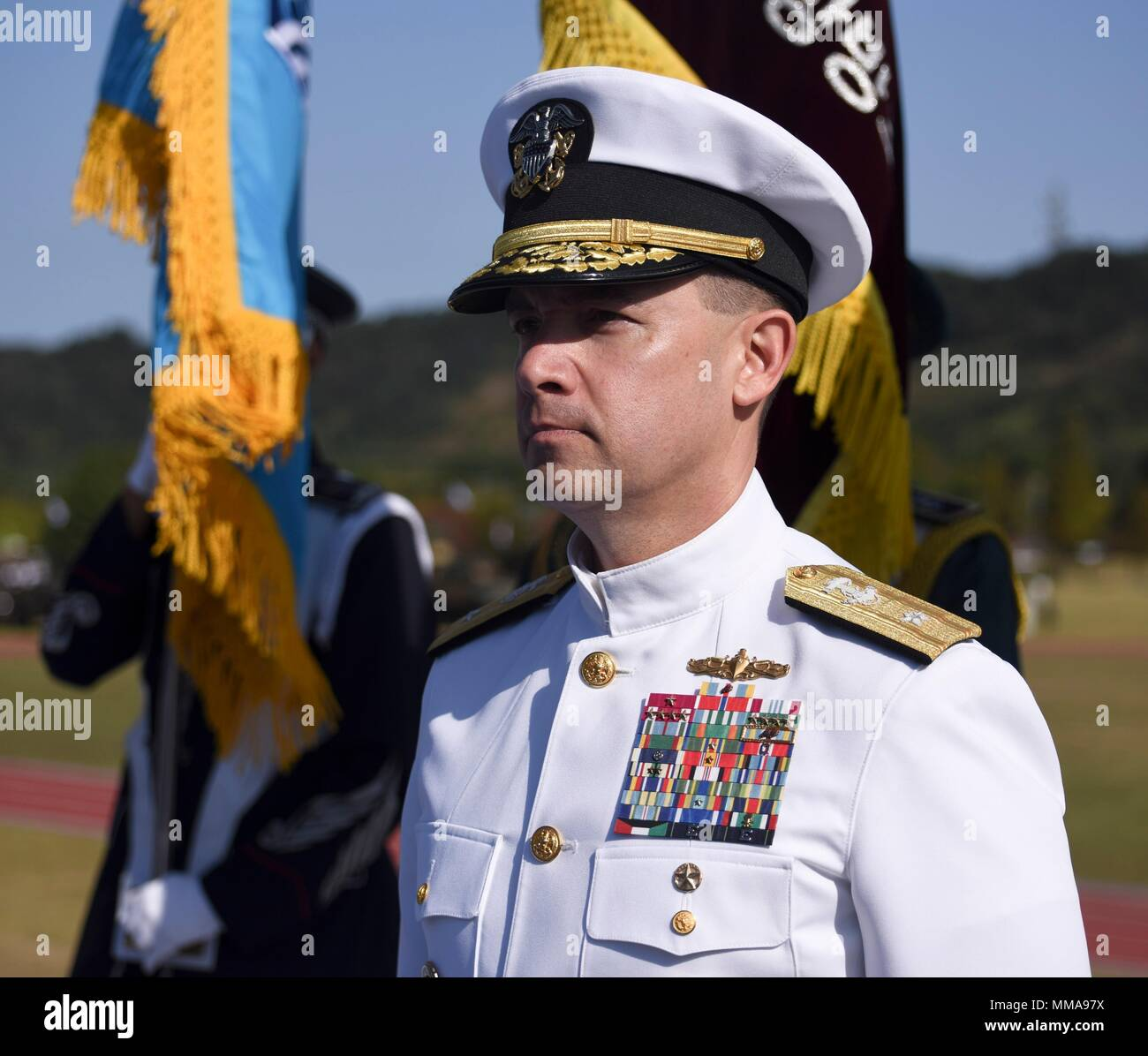 170928-N-TB148-107 PYEONGTAEK, Republic of Korea (Sept. 28, 2017) Rear Adm. Brad Cooper, commander, Naval Forces Korea (CNFK) stands during the 69th annual ROK Armed Forces Day Ceremony. Armed Forces Day commemorates the service of men and women in the ROK armed forces, the day that South Korea broke through the 38th parallel during the Korean War in 1950. Cooper is also presented the Presidential Unit Citation by ROK President Moon, Jae-in, this is the first time a U.S. Navy command is presented this award since the end of the Korean War.  (U.S. Navy photo by Mass Communication Specialist Sea Stock Photo