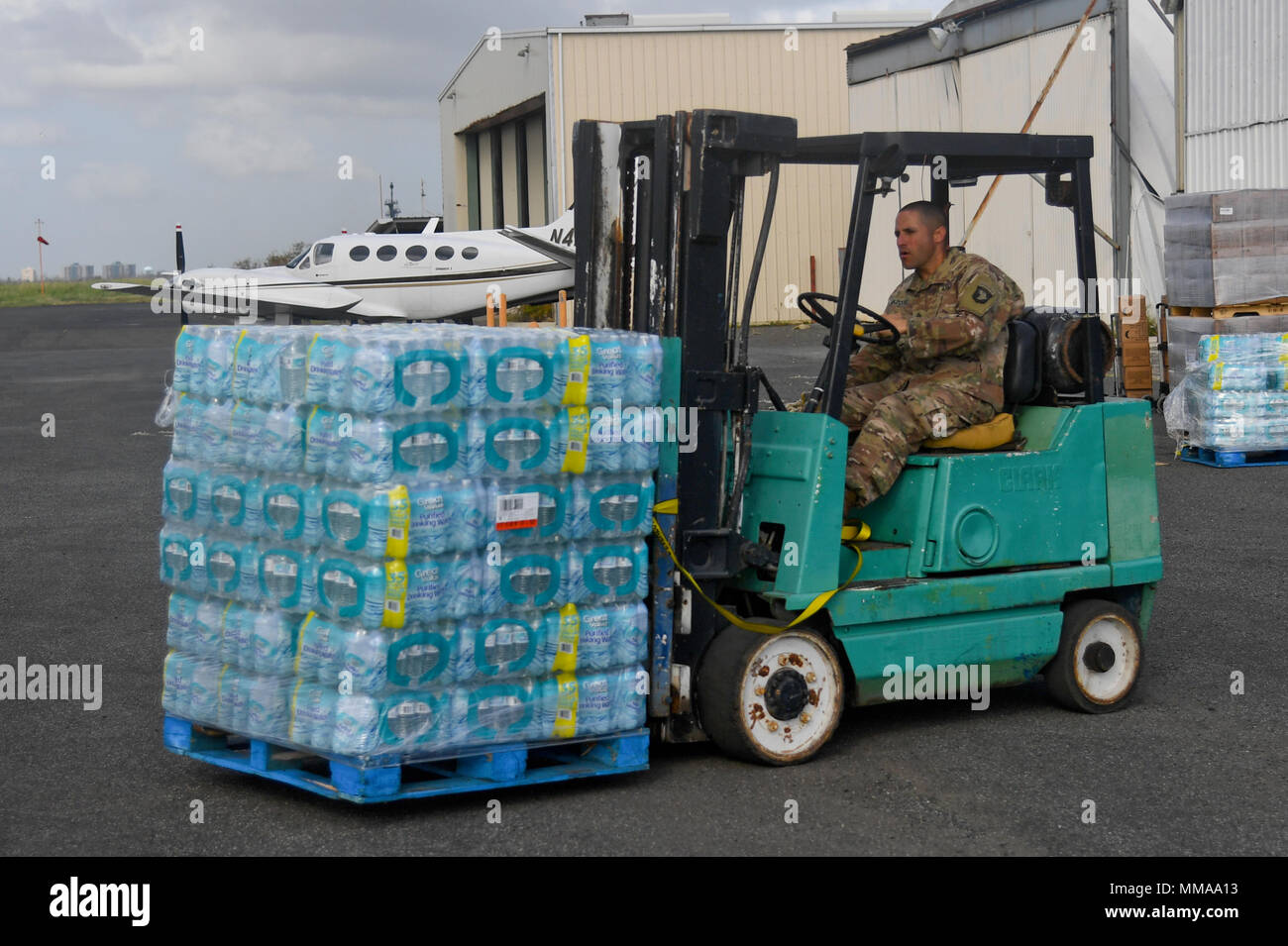 Soldiers with 6th Battalion, 101st General Support Battalion, 101st Combat Aviation Brigade, 101st Airborne Division (Air Assault) prepare to deliver food and water October 3, 2016 in San Juan, Puerto Rico. The Soldiers are supporting the relief efforts in Puerto Rico after the devastating effects of Hurricane Maria. (U.S. Army Photo by Sgt. Marcus Floyd, 101st Combat Aviation Brigade) - Stock Image