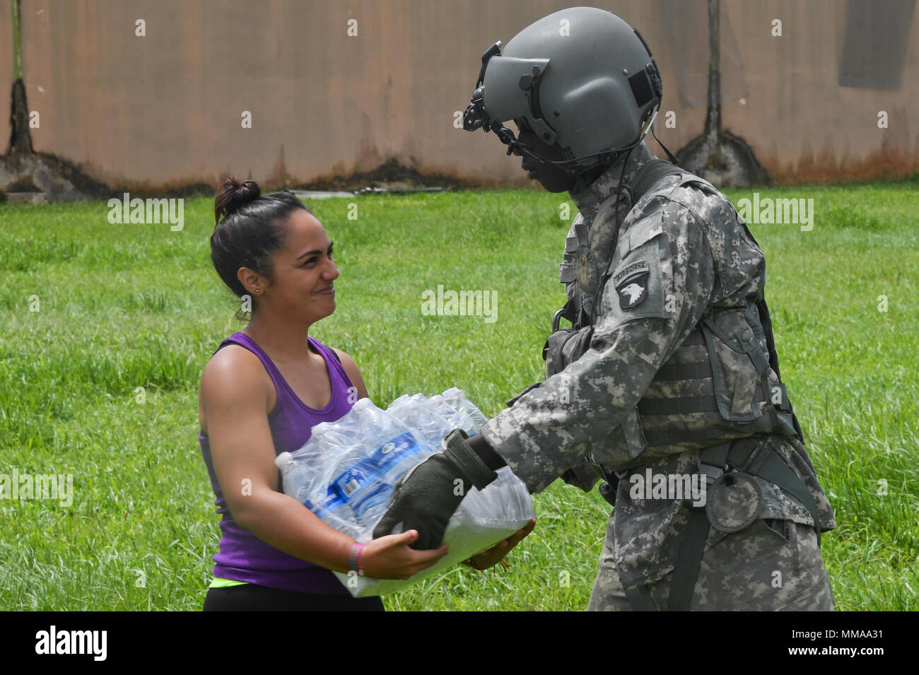 Soldiers with 6th Battalion, 101st General Support Battalion, 101st Combat Aviation Brigade, 101st Airborne Division (Air Assault) deliver food and water October 3, 2016 to Orocovis, Puerto RIco. The Soldiers are supporting the relief efforts in Puerto Rico after the devastating effects of Hurricane Maria. (U.S. Army Photo by Sgt. Marcus Floyd, 101st Combat Aviation Brigade) - Stock Image