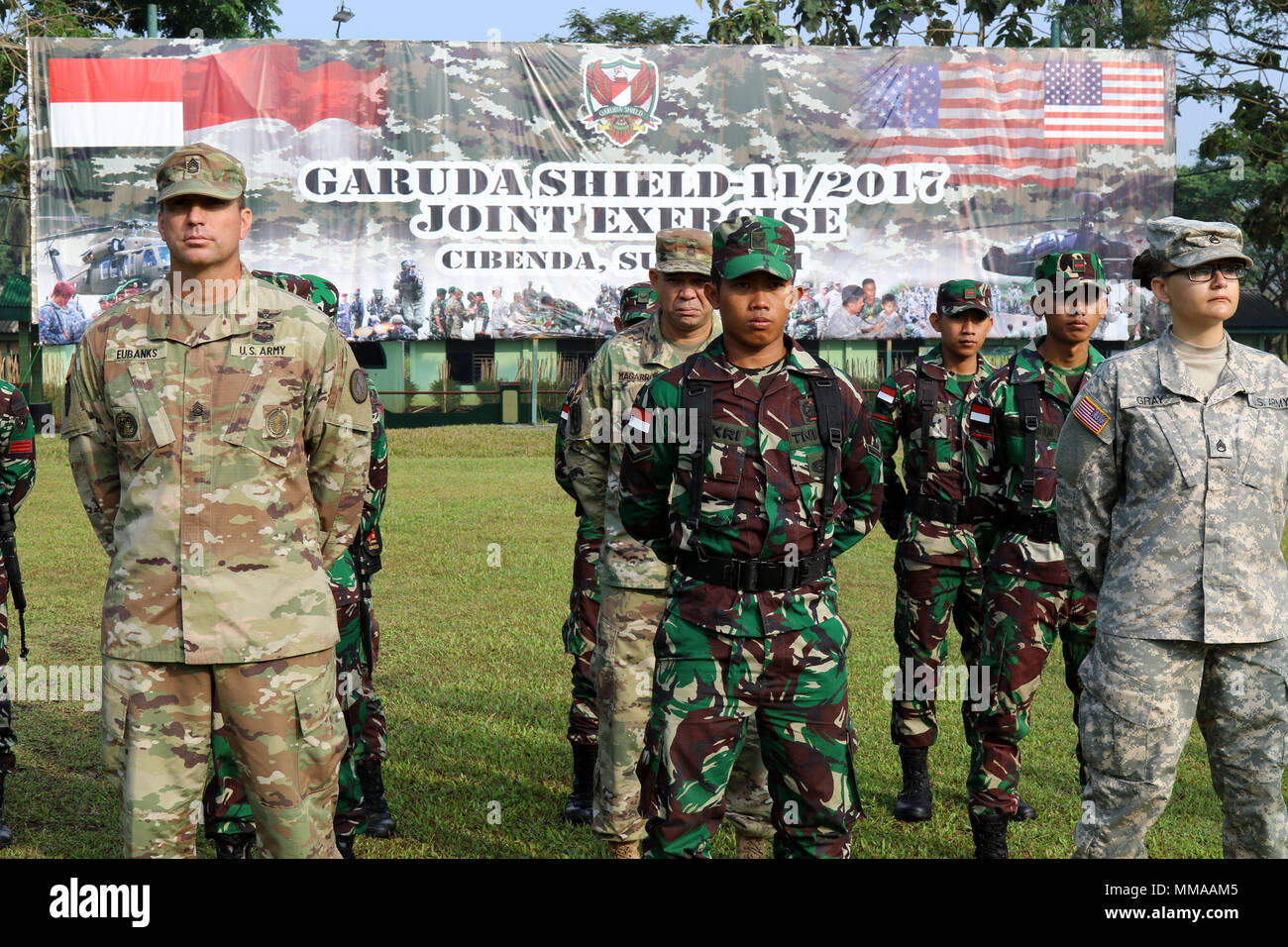 CIBENDA, Indonesia - Soldiers with the Tentara Nasional Indonesia Army (TNI-AD) and U.S. Army stood side-by-side on a parade field during the closing ceremony that officially marked the end of the Garuda Shield 2017 exercise, September 29, 2017 (U.S. Army National Guard photo by Spc. Matthew A. Foster) Stock Photo