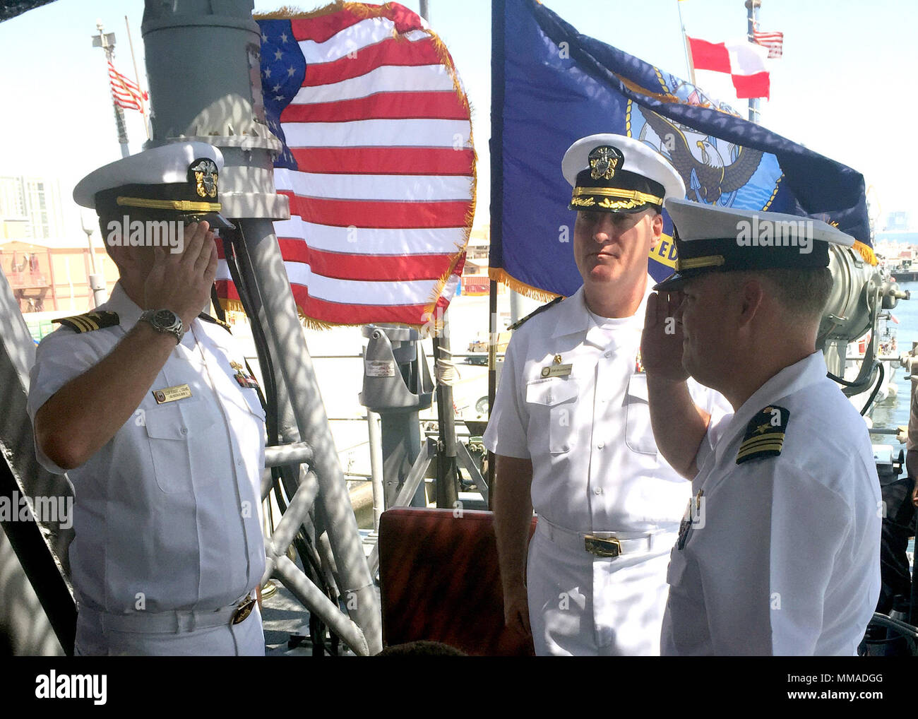 171002-N-PV215-095 MANAMA, Bahrain (Oct. 2, 2017) Lt. Cmdr. Robert J. Toohig Jr., left, relieves Lt. Cmdr. Jeffrey T. Chewning as commanding officer of the Avenger-class mine countermeasures ship USS Dextrous (MCM 13) during a change of command ceremony at Naval Support Activity Bahrain. Dextrous is a part of the newly-commissioned Naval Surface Squadron (CNSS) 5, which serves as the surface type commander's executive agent in Bahrain and provides support to 10 Cyclone-class coastal patrol ships and four Avenger-class mine countermeasures ships. (U.S. photo by Mass Communication Specialist 1st - Stock Image