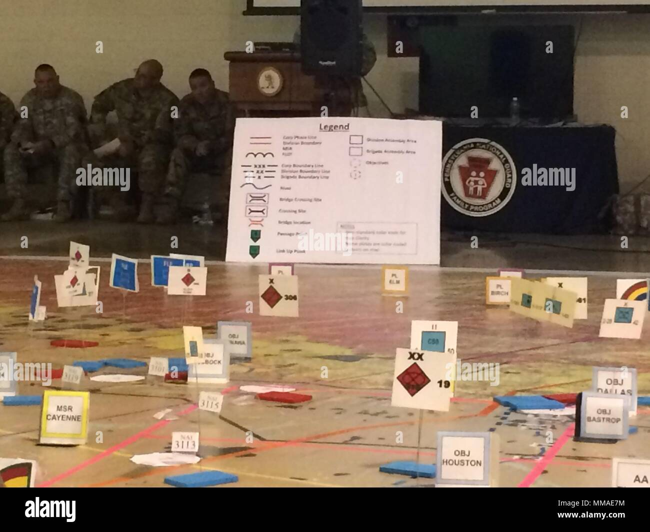 Cardboard markets indicate enemy units and objectives on a giant map at Fort Indiantown Gap, Pennsylvania on Oct. 4, 2017, as leaders of the New York Army National Guard's 42nd Infantry Division conduct a Rehearsal of Concept exercise during their Warfighter exercise. Leaders move markers representing their units and discuss their actions at that phase of the battle to ensure that all leaders and staff understand the plan. ( U.S. Army National Guard photo by Capt. Jean Kratzer) - Stock Image
