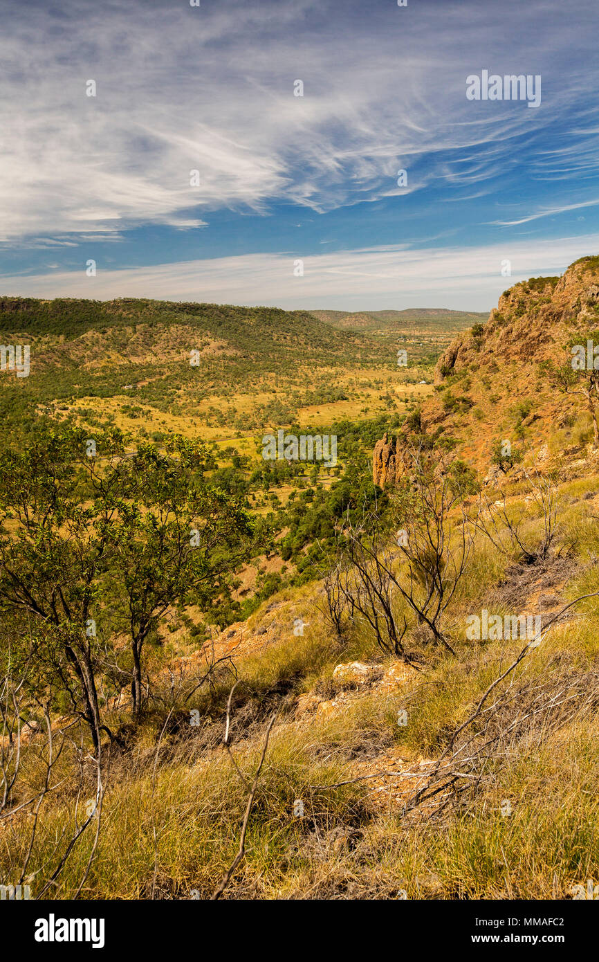 View of vast outback landscape of ranges and plains under blue sky from lookout at Minerva Hills National Park, near Springsure Queensland Australia - Stock Image