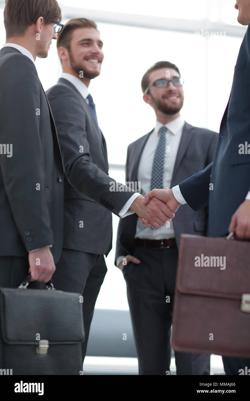 business partners shaking hands - Stock Image