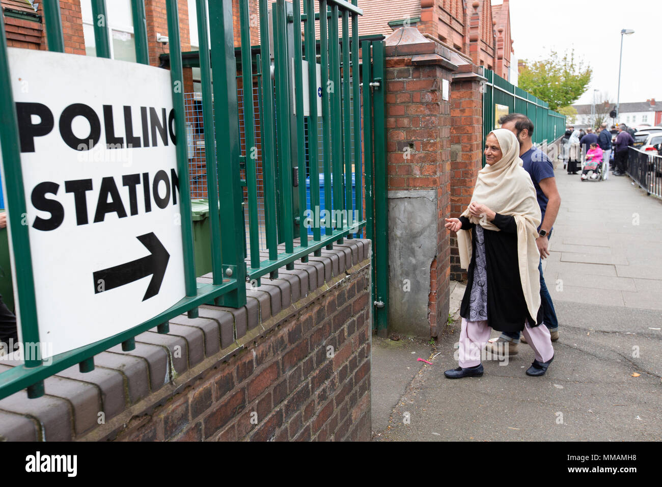 Muslim voters arriving at a polling station in Small Heath, Birmingham, for the local elections in May 2018. - Stock Image