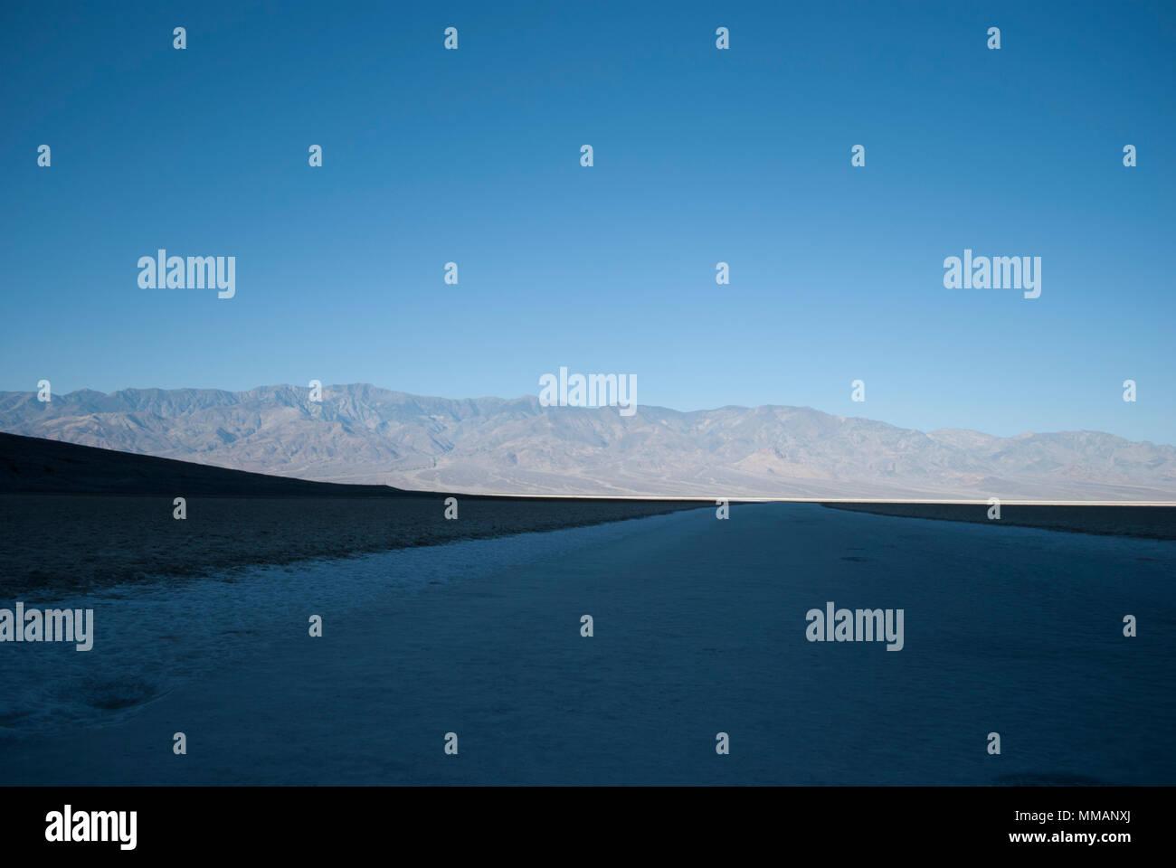 Mountains view. Sandy land. Desert. Hot weather. Summer. Vacation destination. Fantasy landscape - Stock Image
