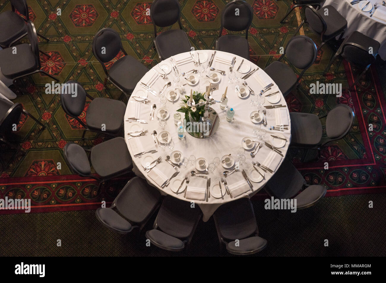An aerial view of a round table in the dining room on the third floor of the National Liberal Club at 1 Whitehall Place in Westminster, London. Photo  - Stock Image