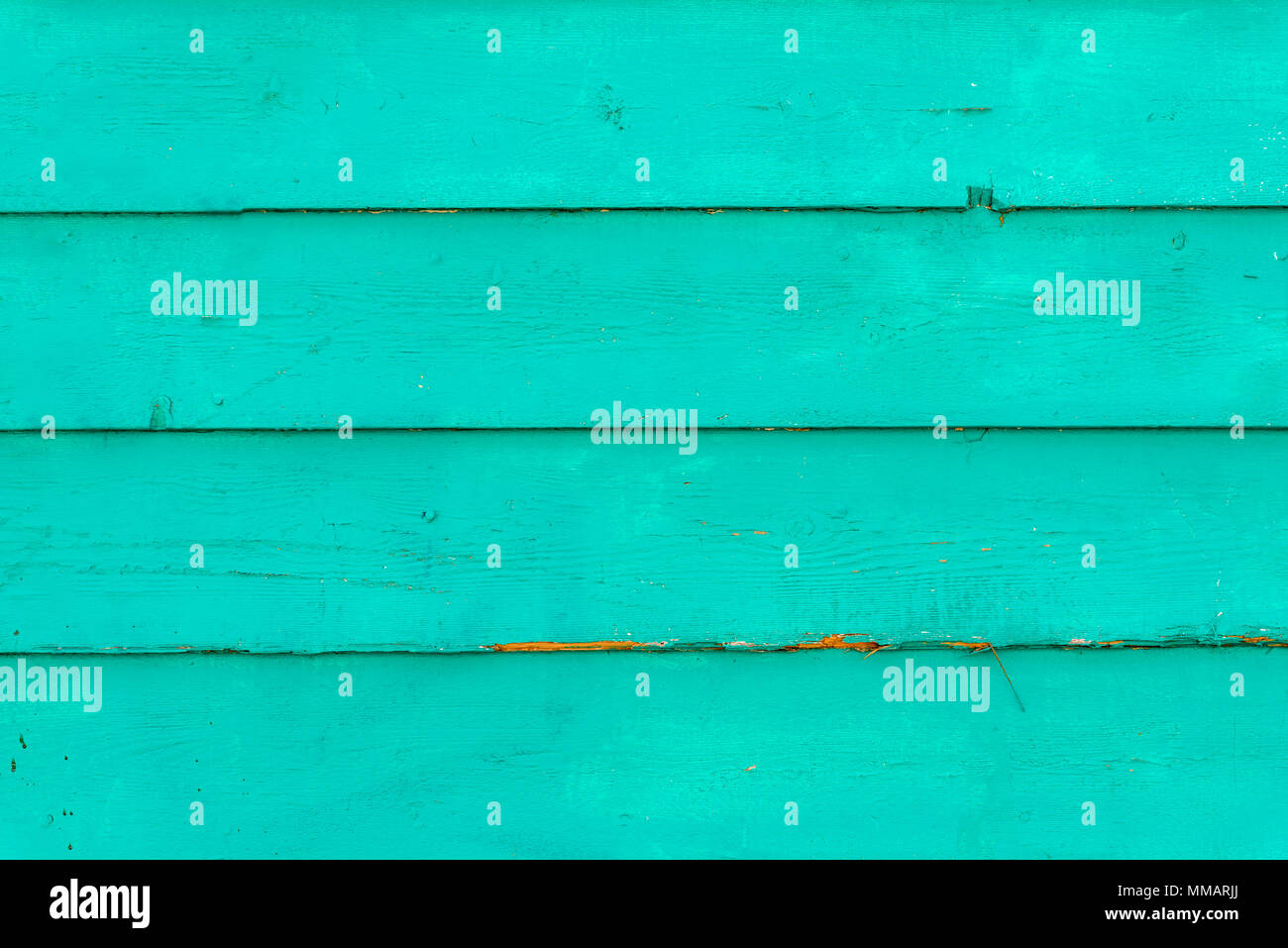 A teal green wooden background - Stock Image