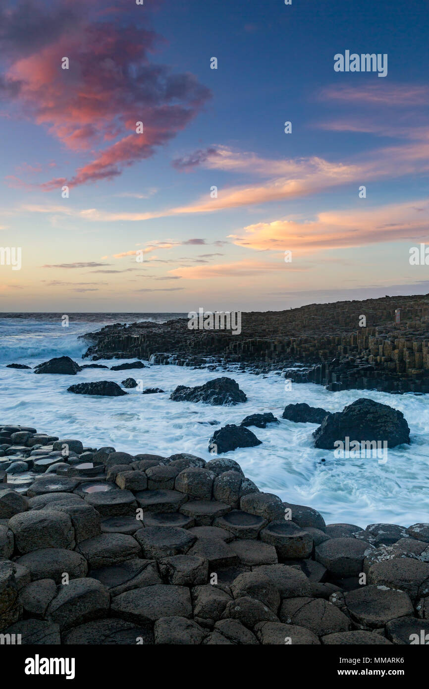 Sunset over the Giant's Causeway, County Antrim, Northern Ireland - Stock Image