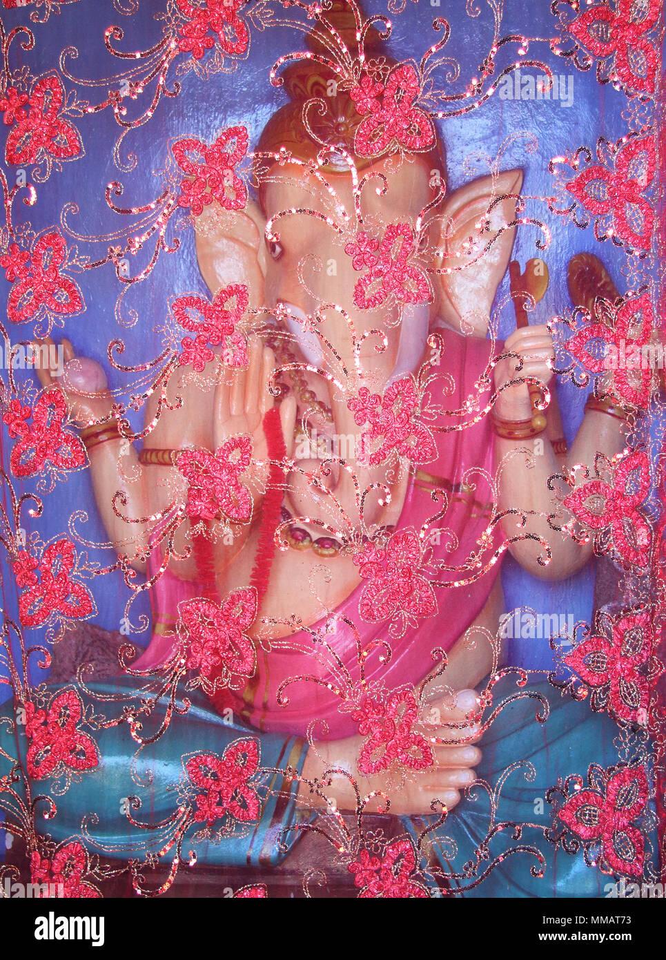 Hindu Ganesha god in kitsch colors - Stock Image