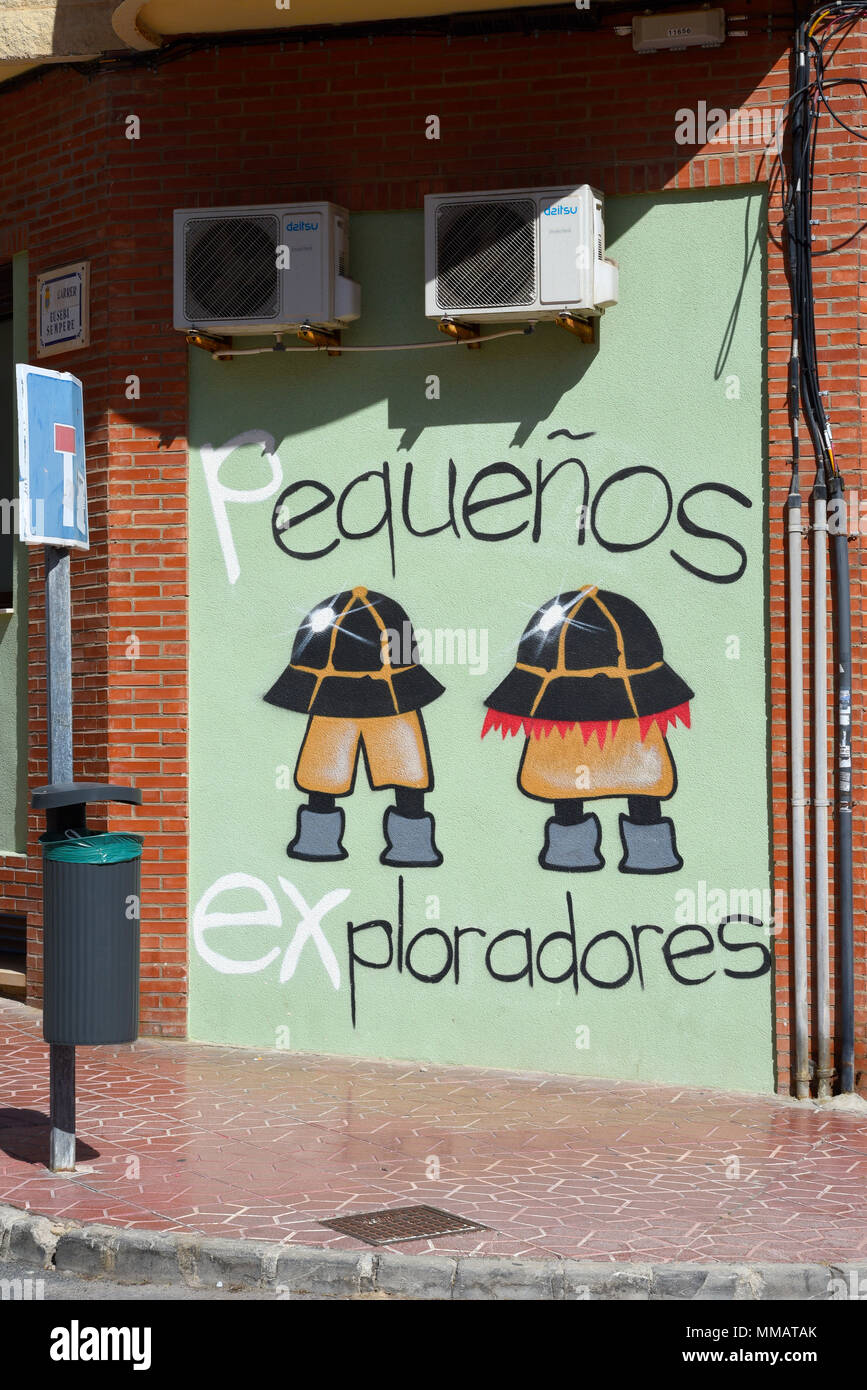 Pequenos Exploradores graffiti on a wall in Guardamar, Spain. Small Explorers cartoon children's characters. Exterior wall art artwork - Stock Image