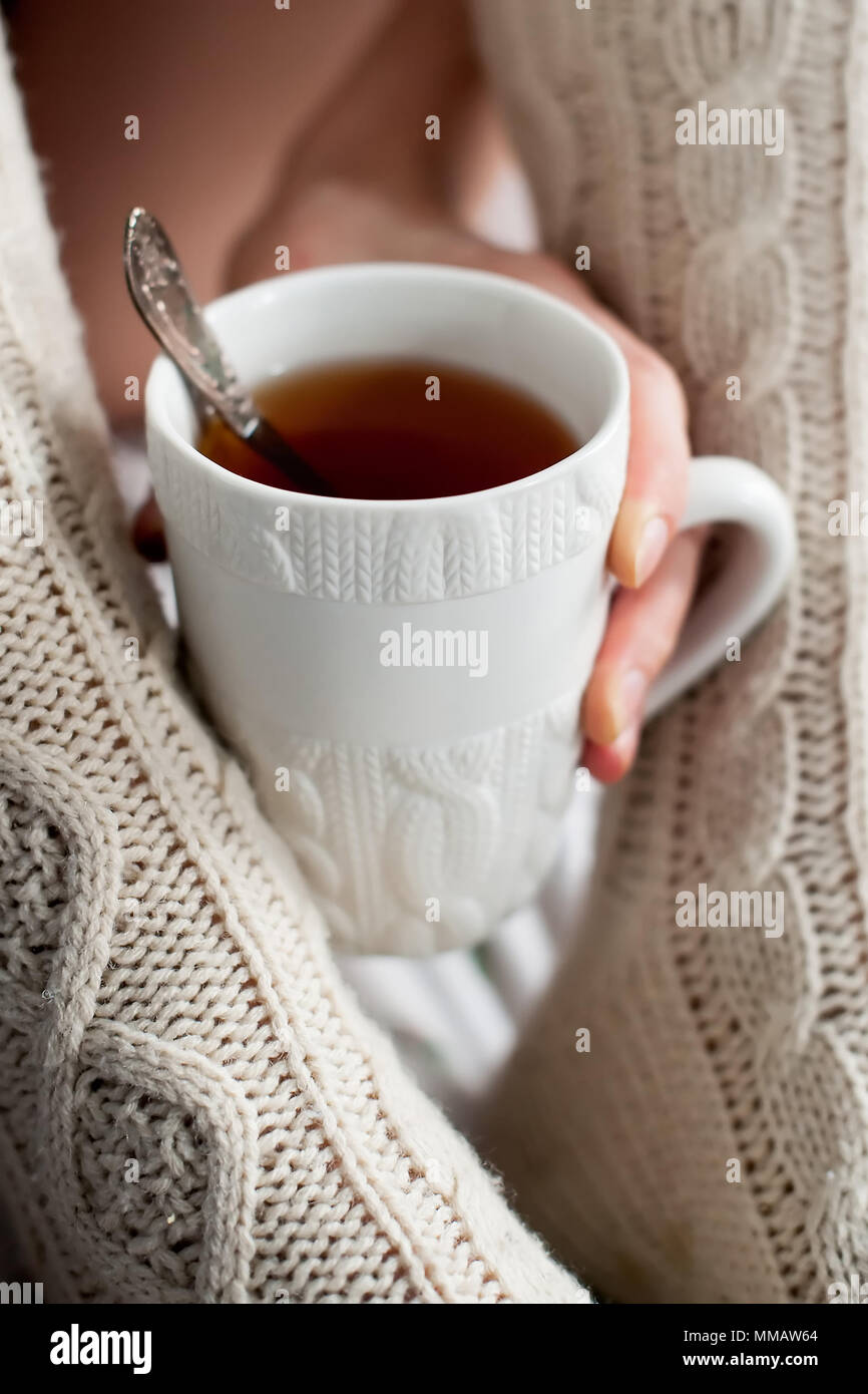 Cup of tea and matching socks - Stock Image