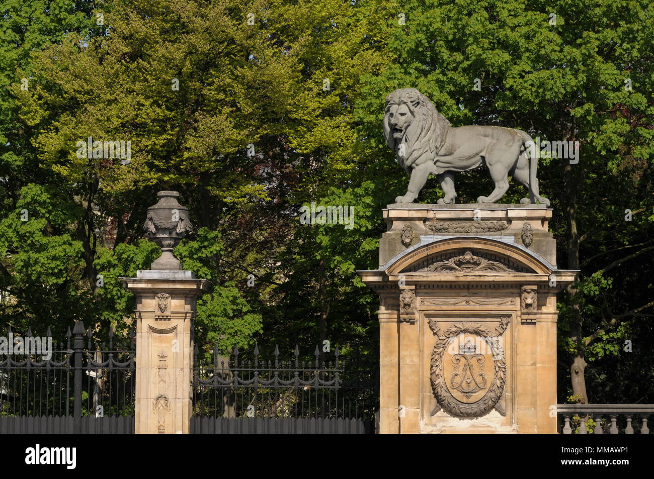A Lion sculpture guarding entrance to the Royal Palace in Brussels - Stock Image