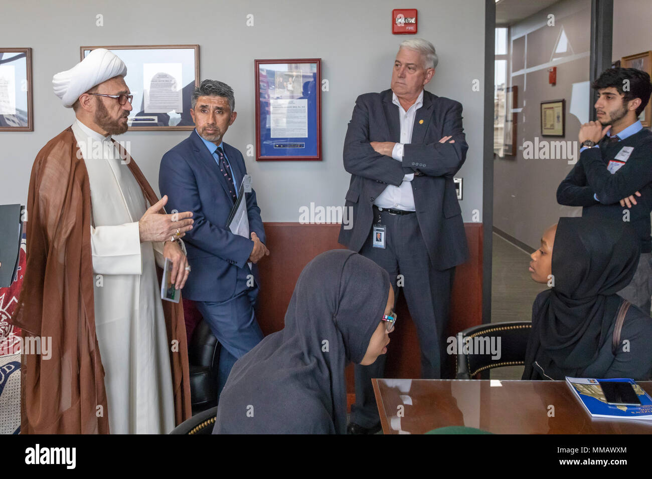 Lansing, Michigan - Imam Mohammad Ali Elahi speaks with Republican State Senator Ken Horn during the annual Michigan Muslim Capitol Day at the state c - Stock Image