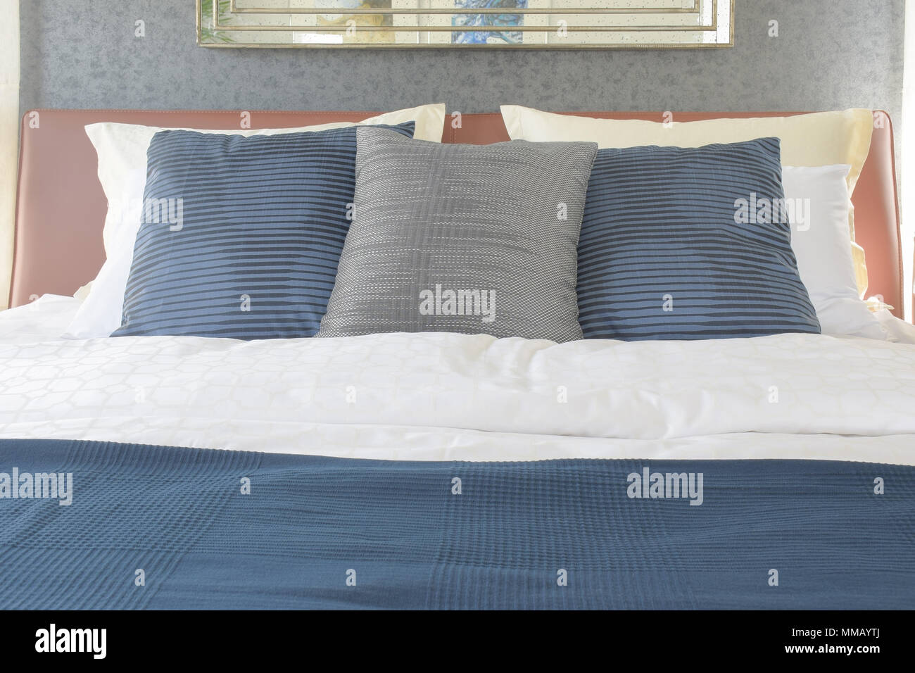Dark Blue And Gray Pillow On Bed With Brown Leather Headboard Stock Photo Alamy